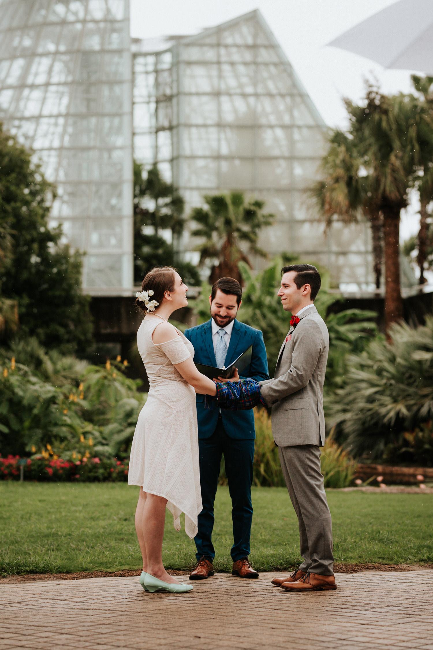 Couple getting married at rainy San Antonio Botanical Garden Wedding