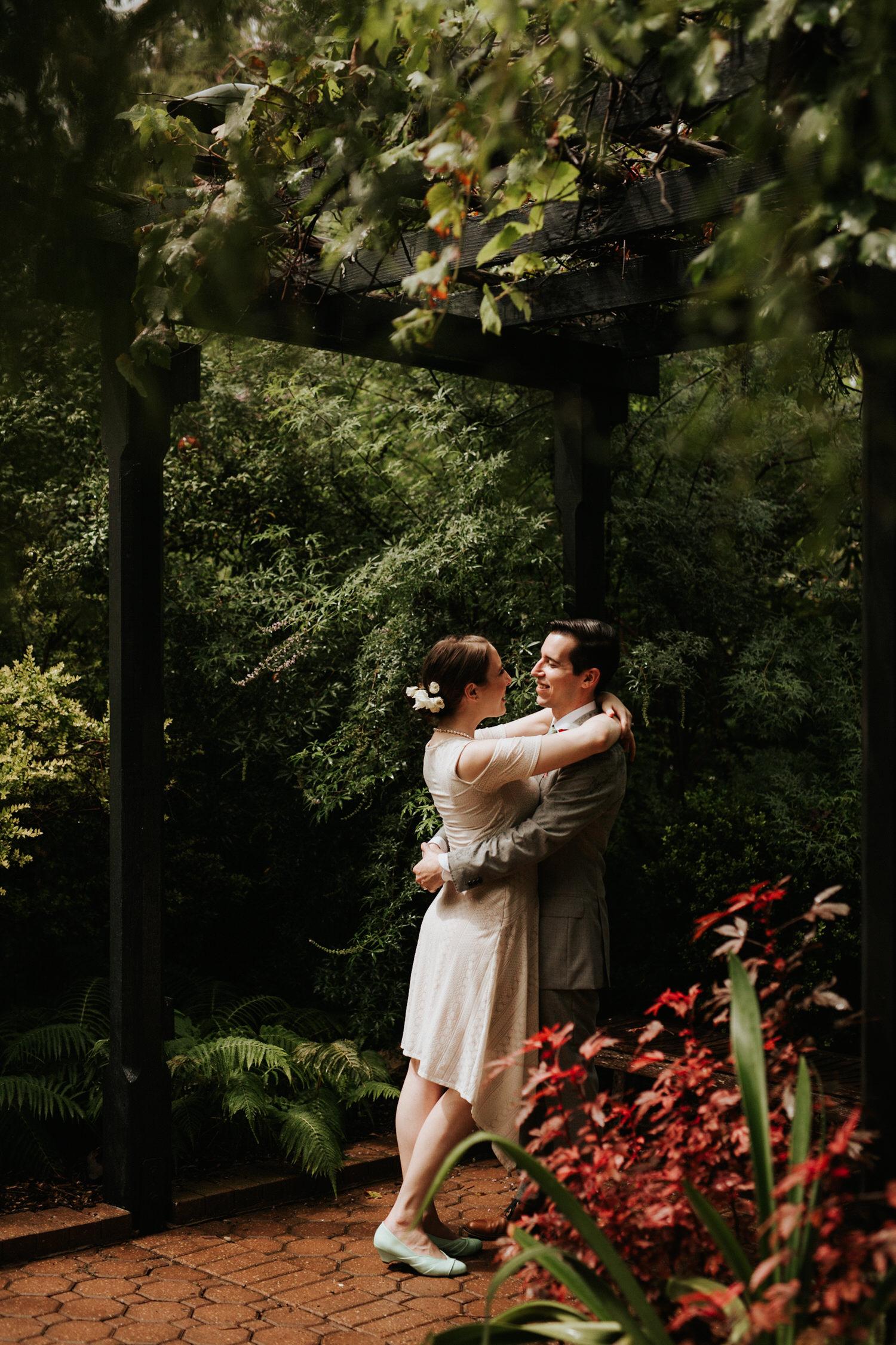 Bride and groom at rainy San Antonio Botanical Garden Wedding