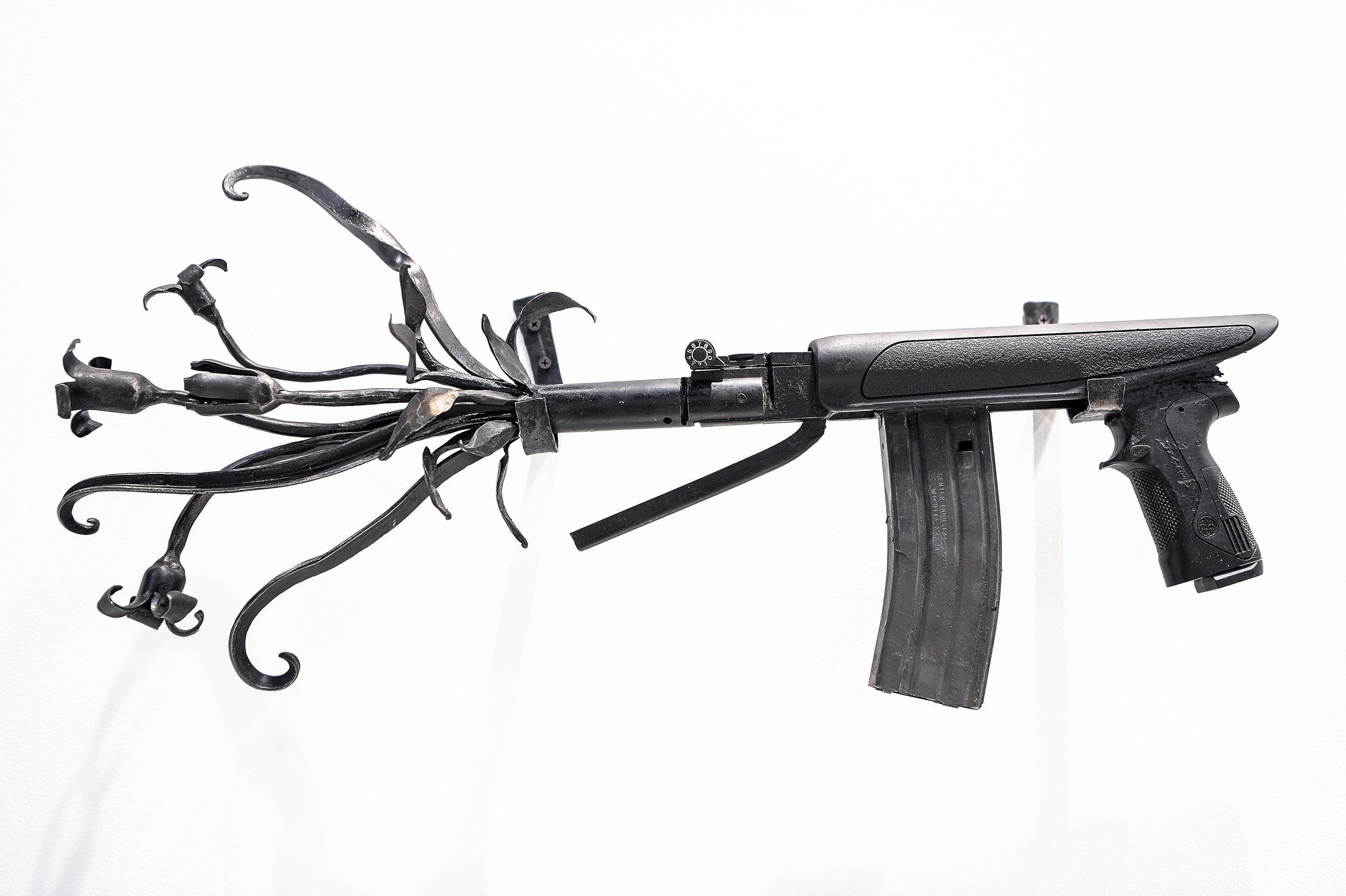"Flourish ,  2019, recycled guns and gun barrels, forged steel, 13.5"" x 28"" x 5"""