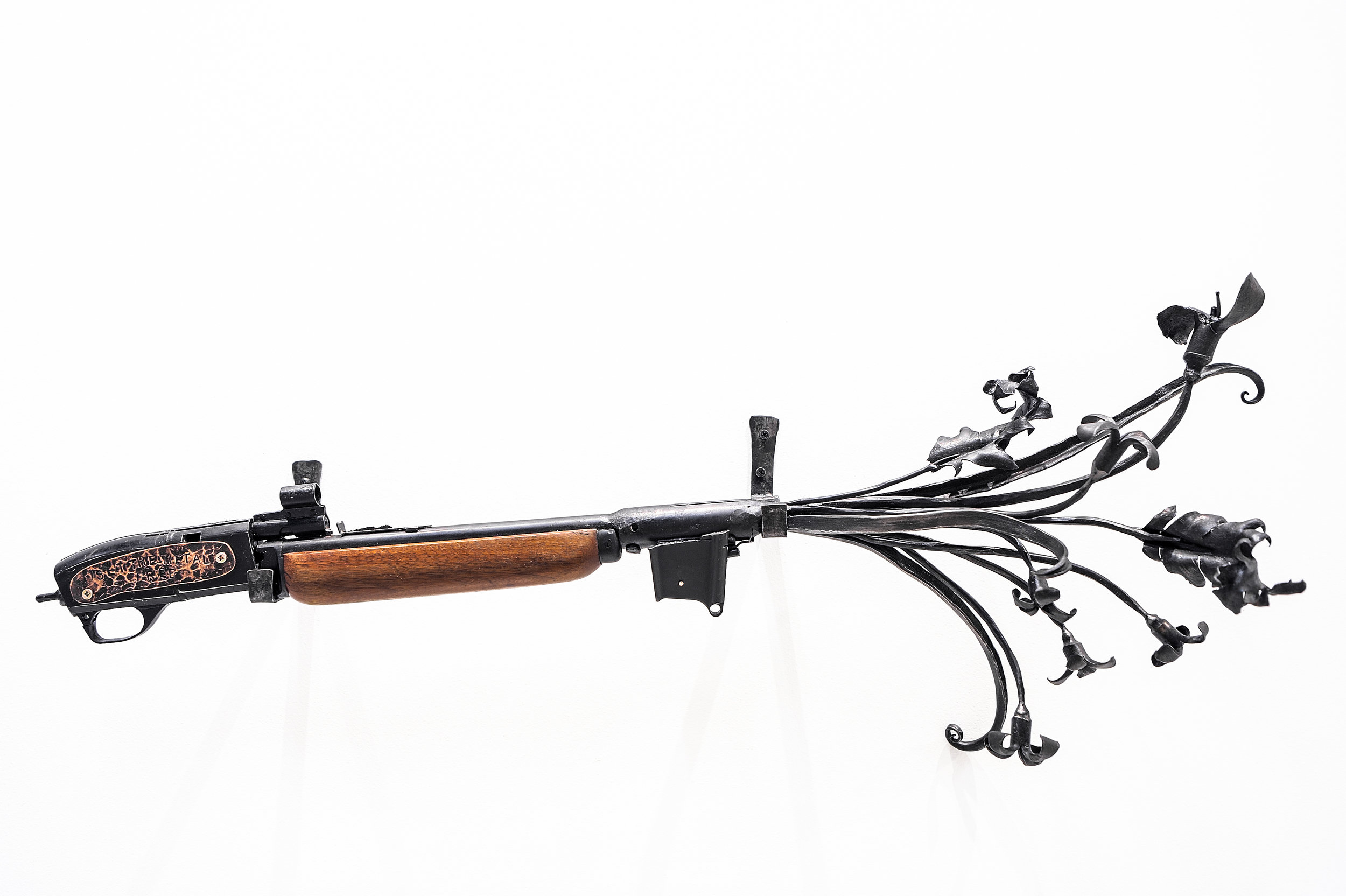 """Set the Metal Free ,  2019, recycled guns and gun barrels, forged steel, 16.5"""" x 39"""" x 8"""""""