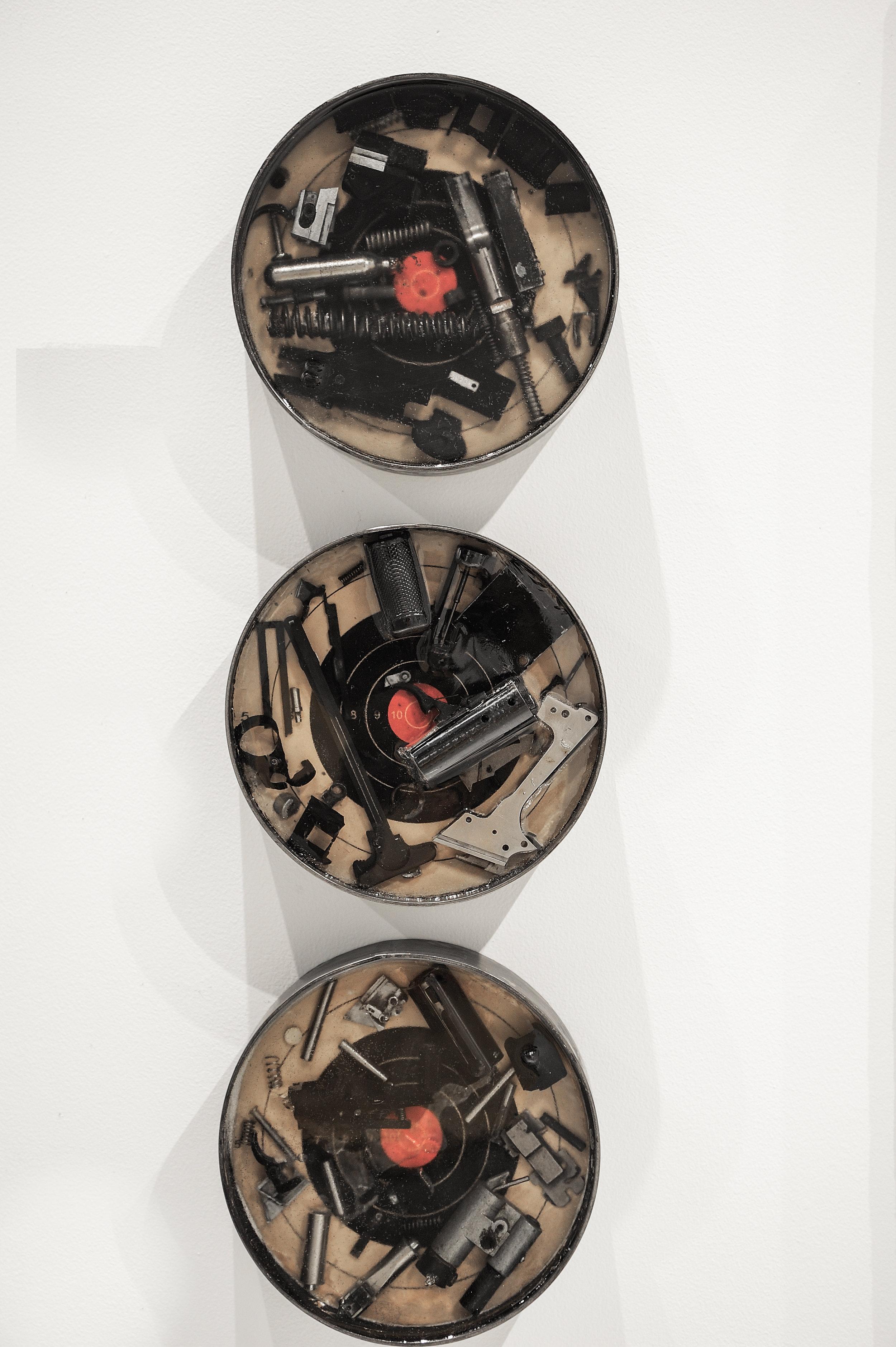 """Artifact I, II, & III   ,  2019, steel, resin, gun parts, paper target, 9.125"""" x 9.125"""" x 2"""""""