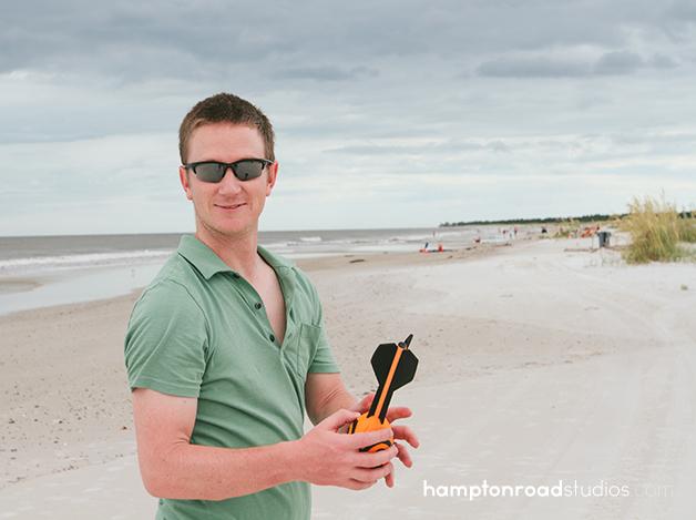 matt holding football on beach