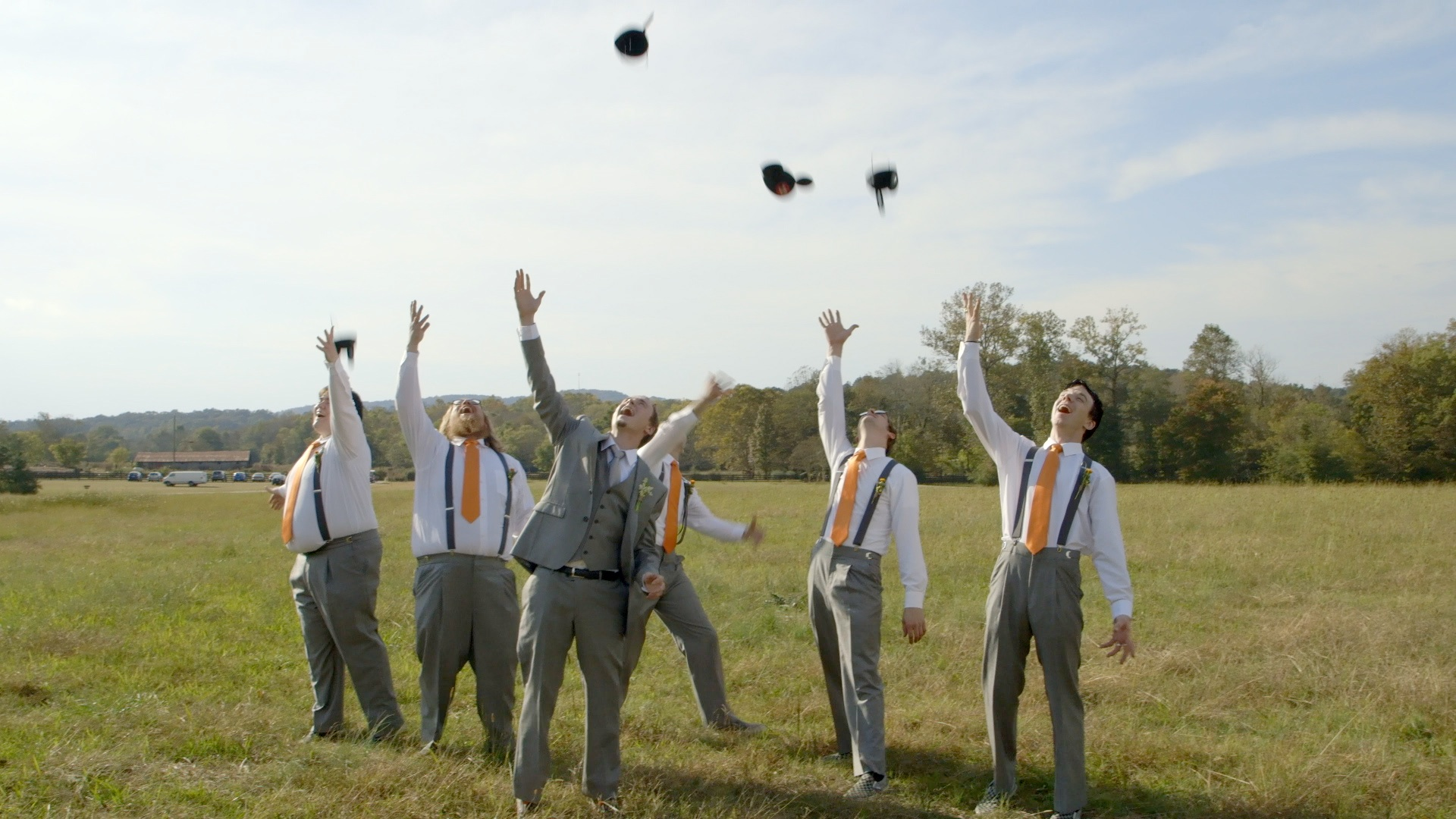Jon and his groomsmen tossing their Mickey hats into the air for a photo op.