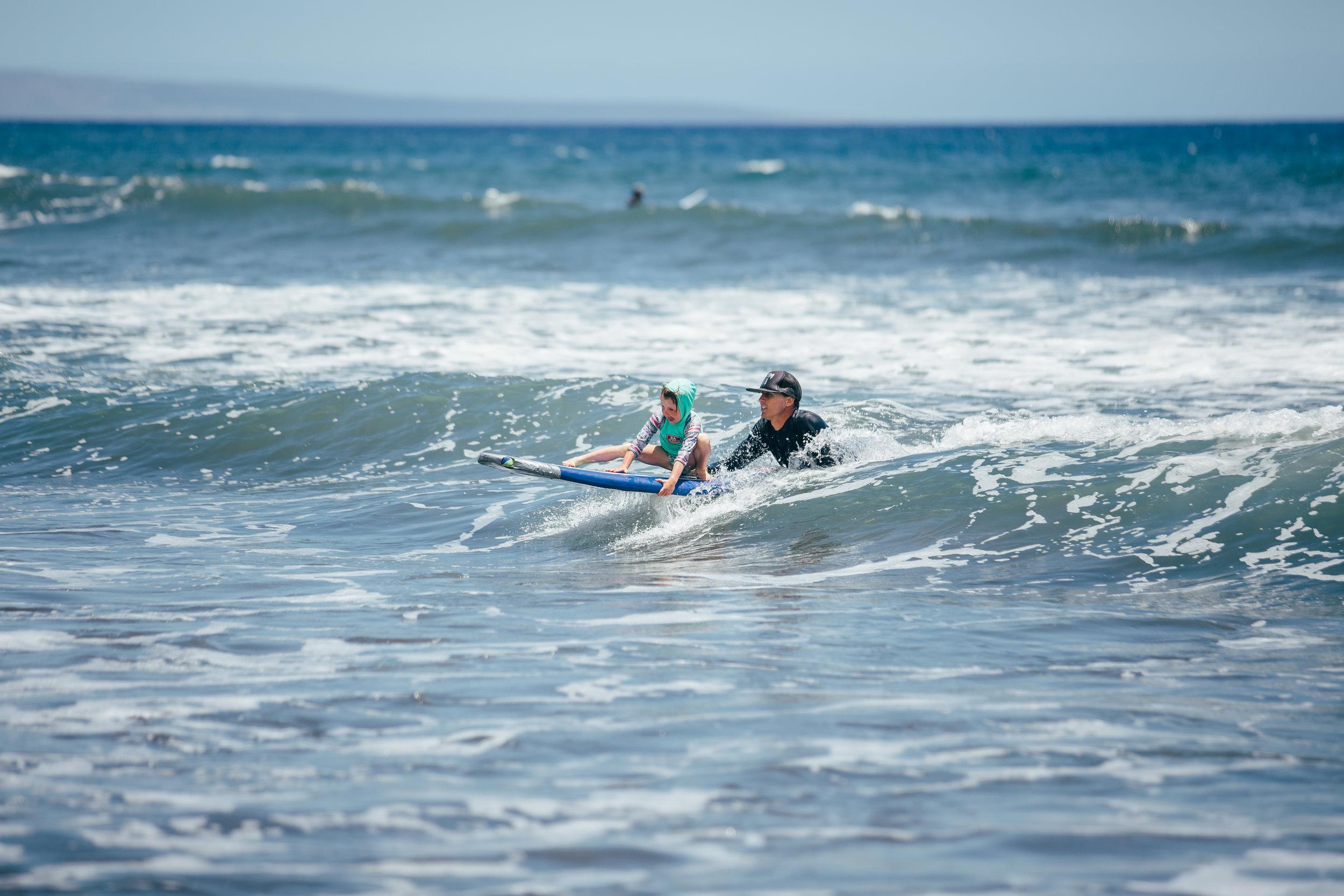Sean teaching Iris to surf