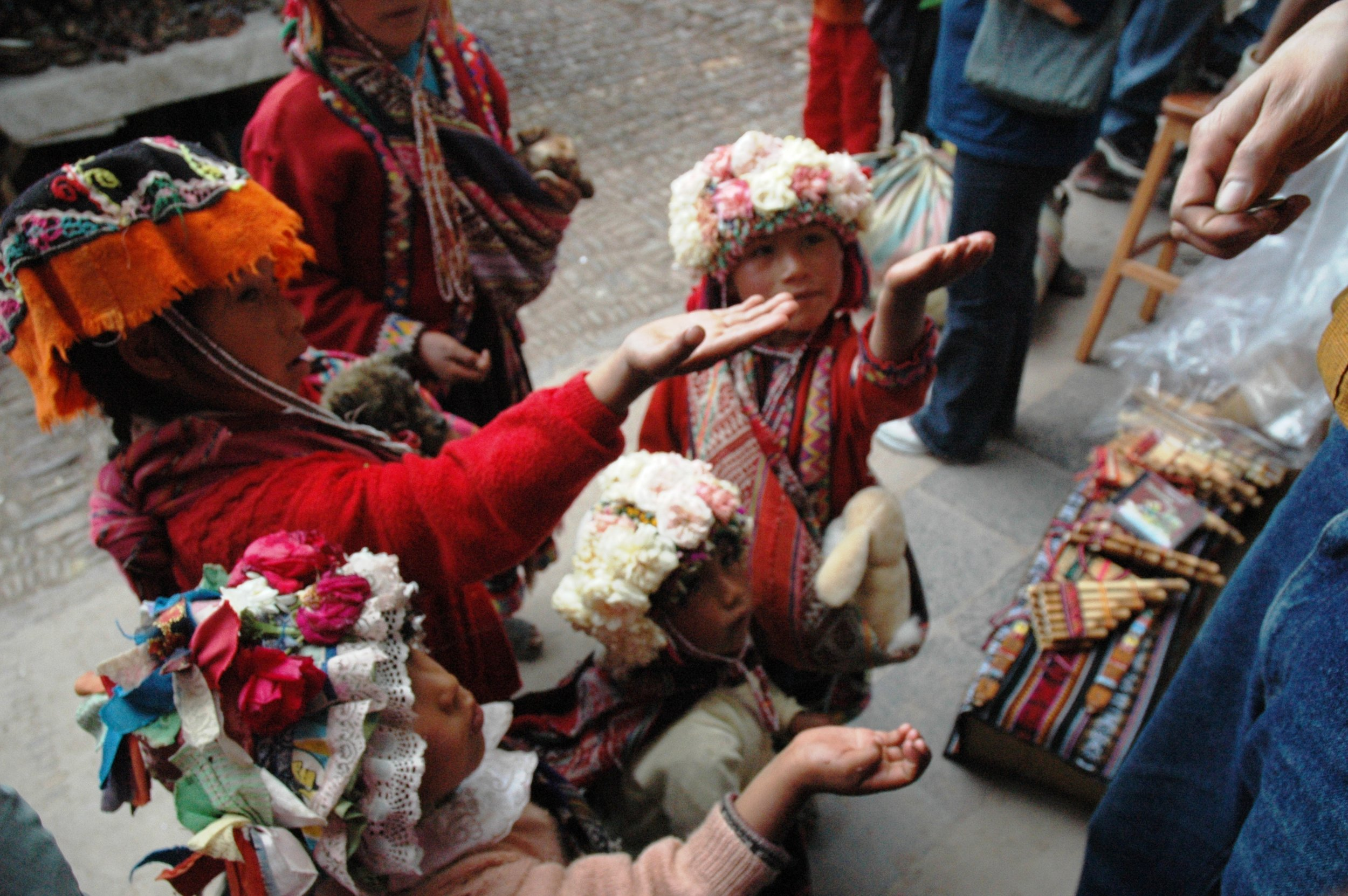 Kids expecting money at the Pisac Market in Peru