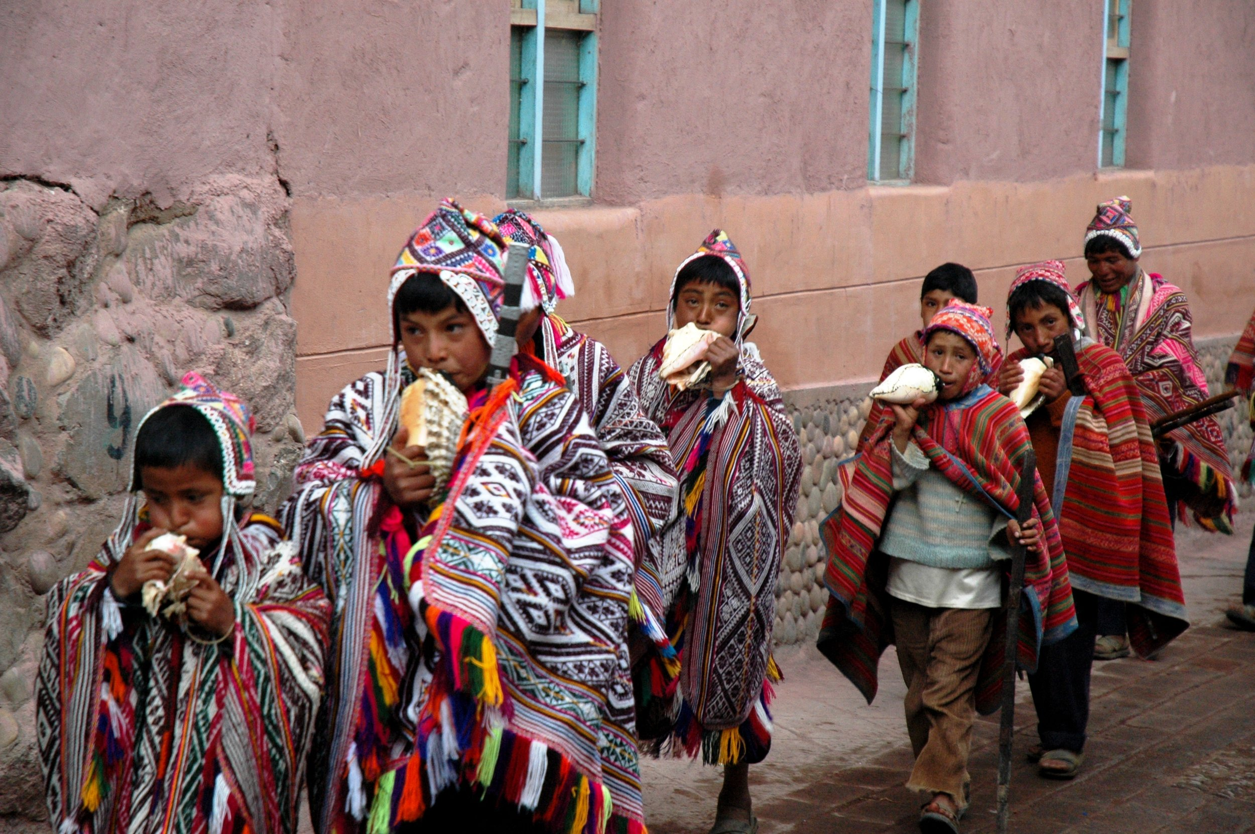 A traditional procession at the Pisac Market, Peru