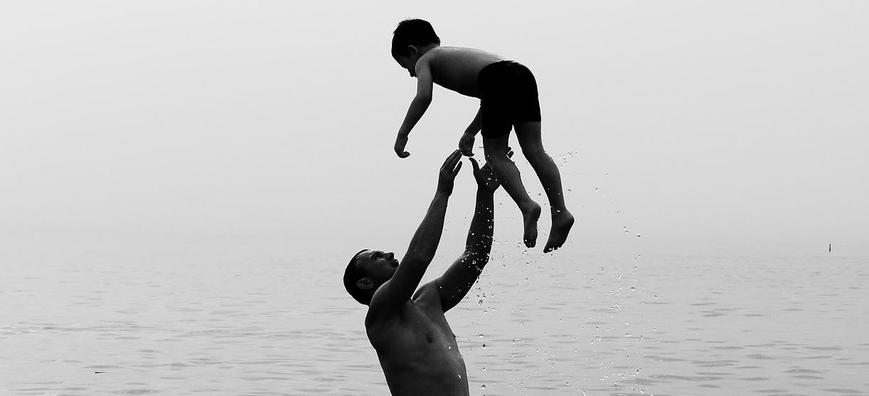 man-throwing-son-in-water.jpg