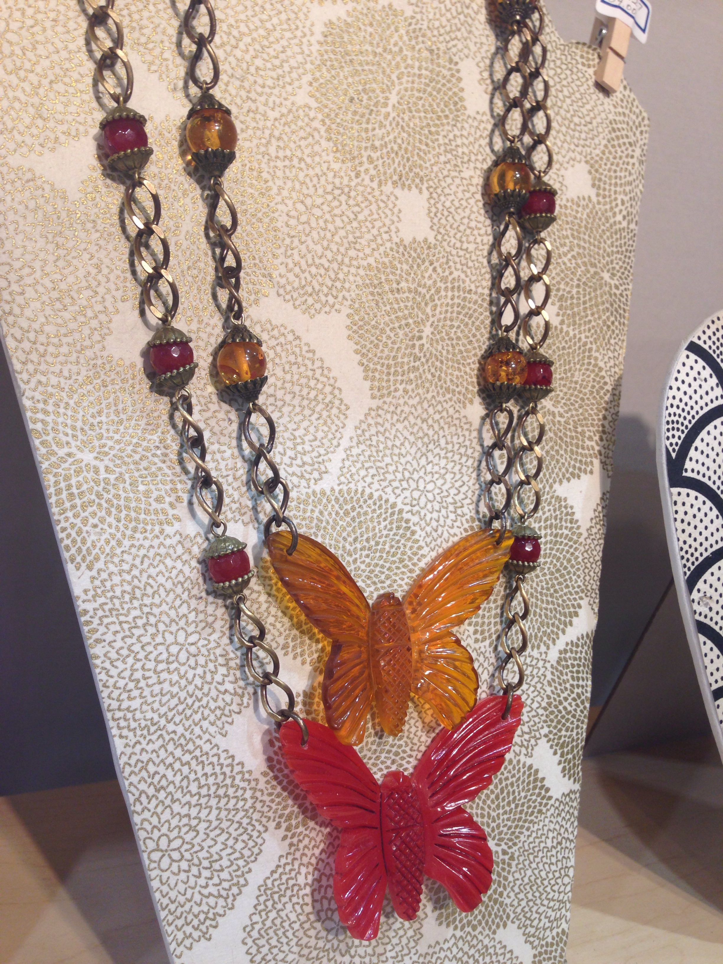Butterflies in red and apple juice. The apple juice is paired with amber, the red butterfly is paired with carnelian.