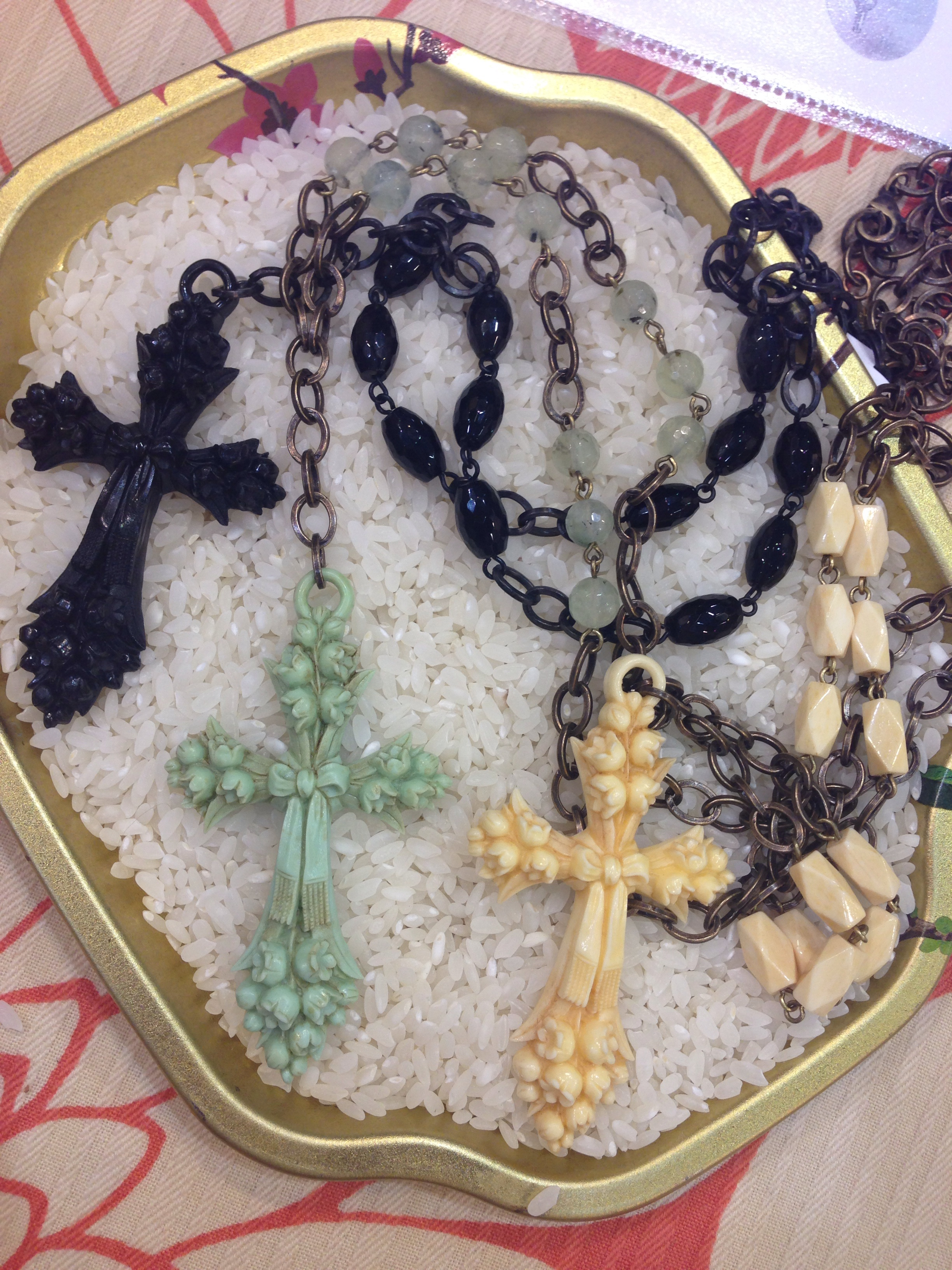 Crosses! These were inspired from a cross dated in the 1880's! We really love the little bow and lillies on them.