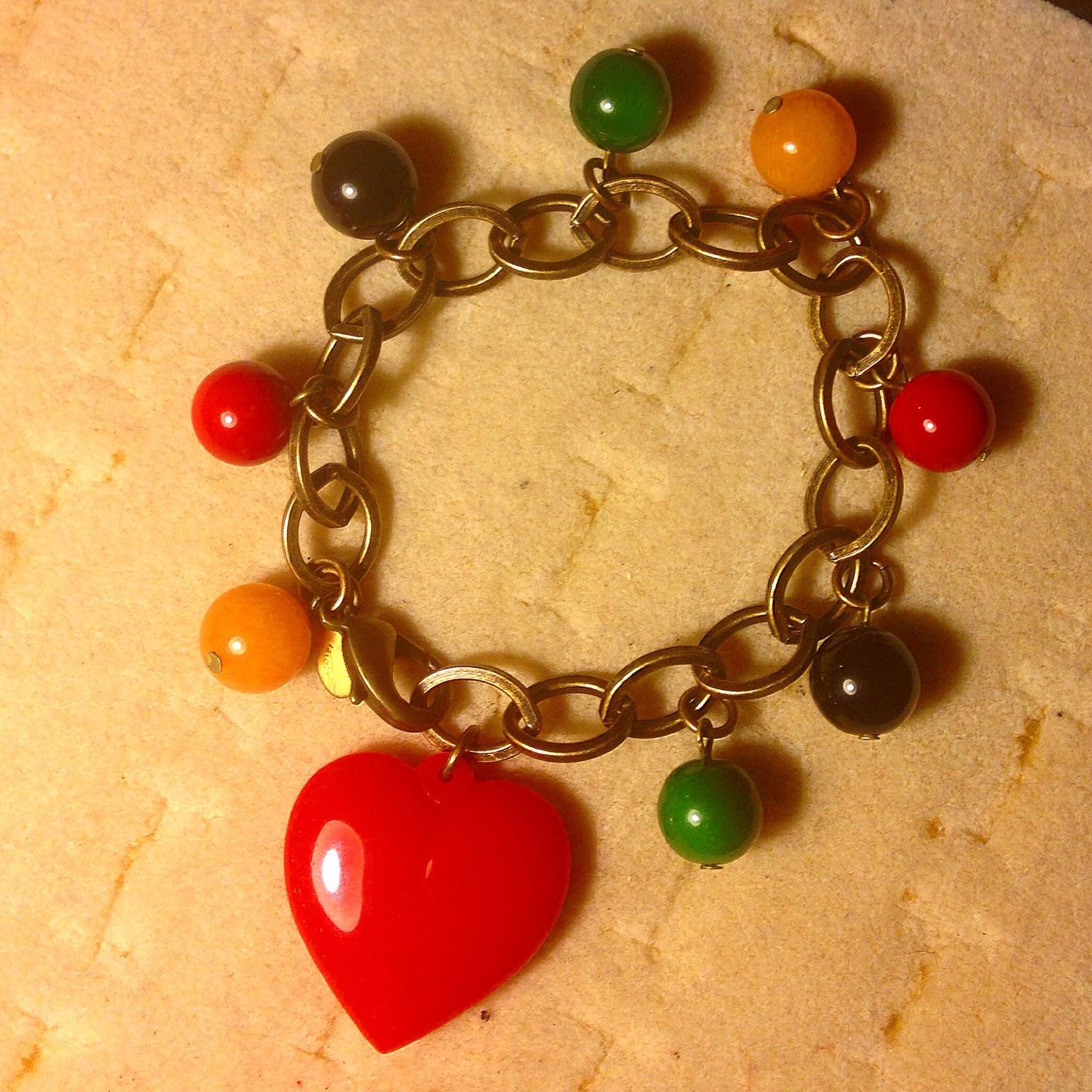 Charm bracelet! Very bakelite color theme! Very adjustable
