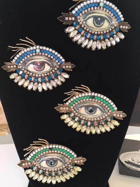 Amazing eye brooches, these are made by for Harrod's in London... In the eye corner....