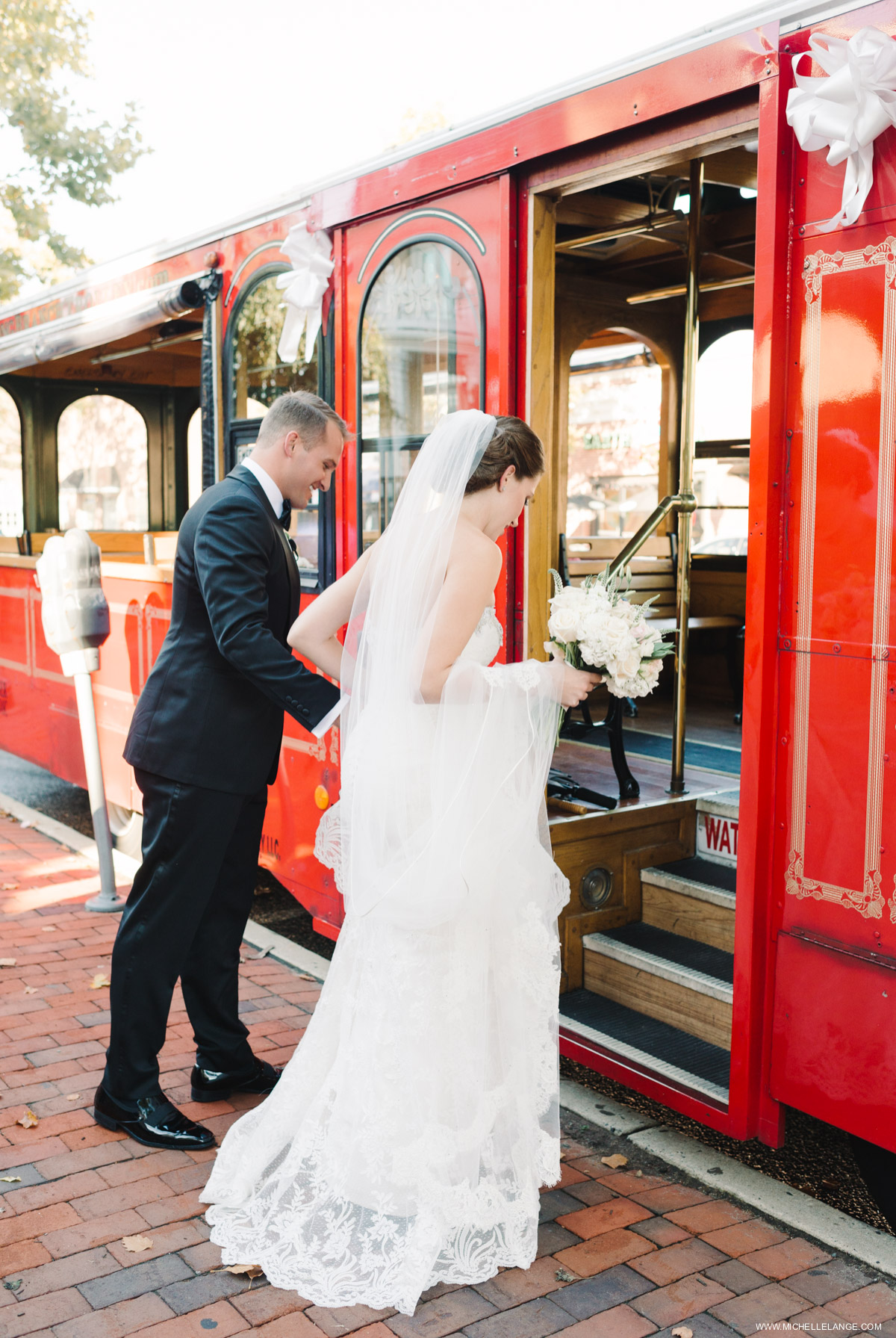 Bride and Groom Leaving on Trolley Riverhouse at Rumson Country Club Wedding