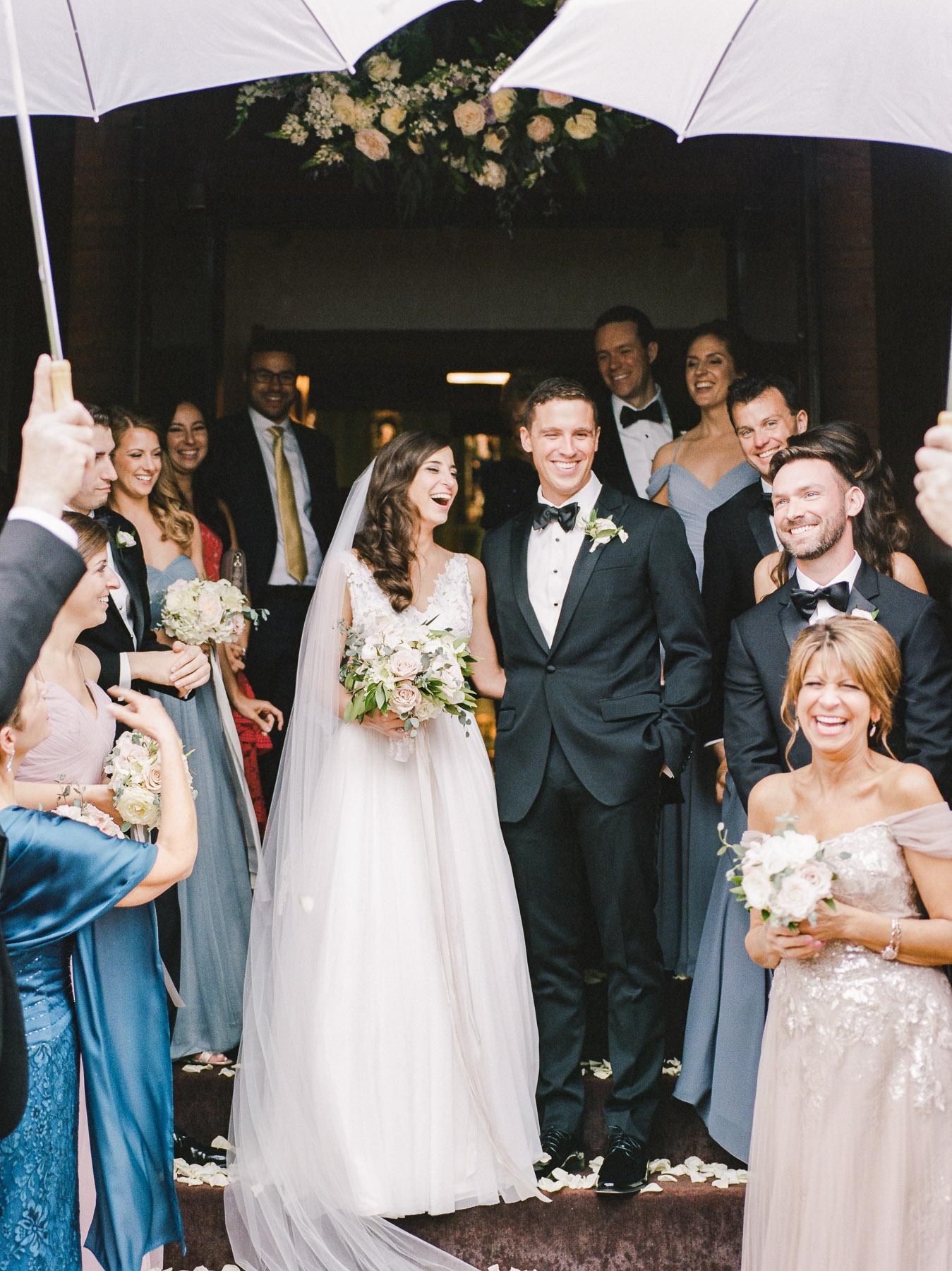 Exit of Church on Rainy Wedding Day