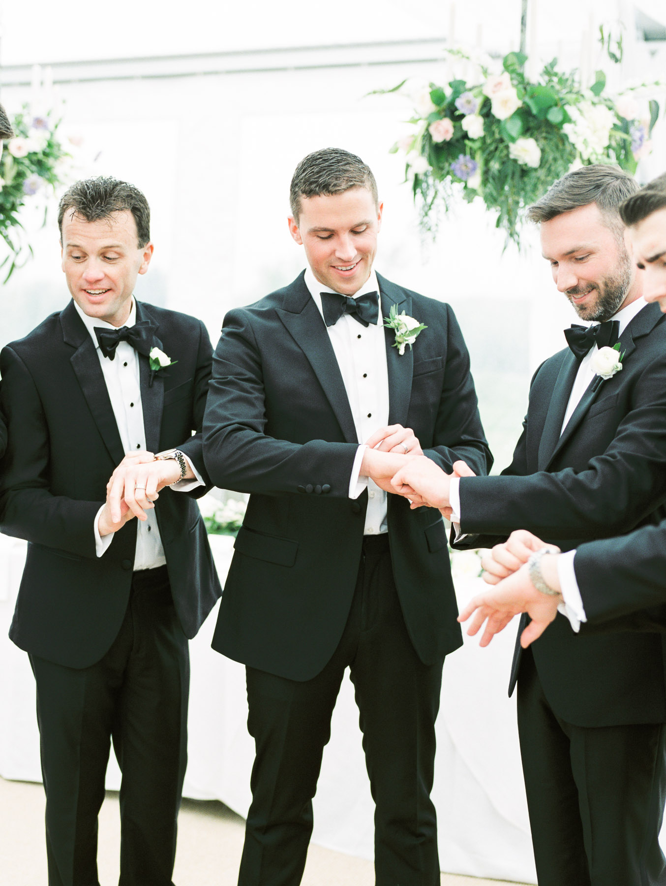 Groomsmen checking time