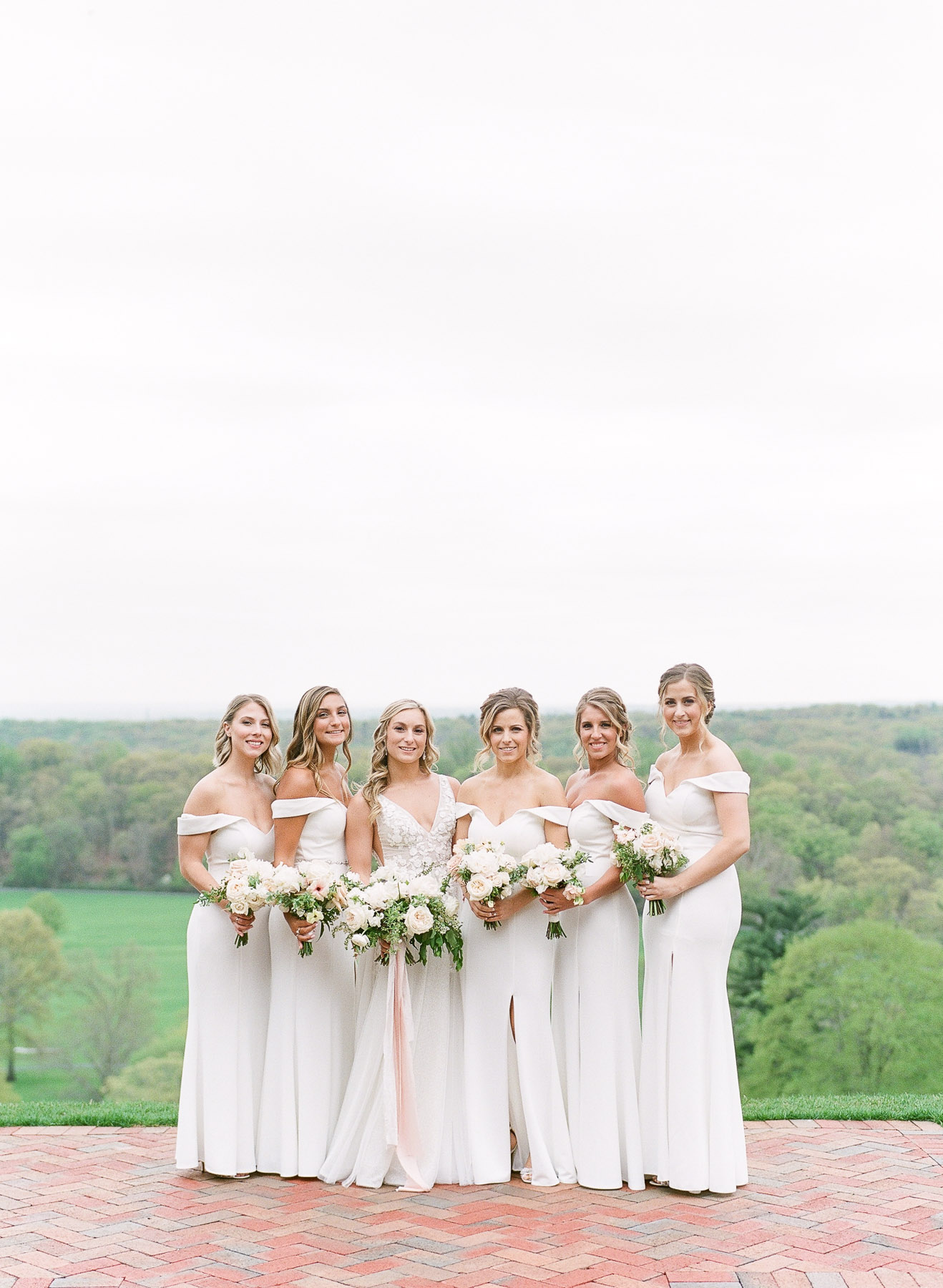 Bridesmaids in white dresses at NJ wedding at Natirar Mansion