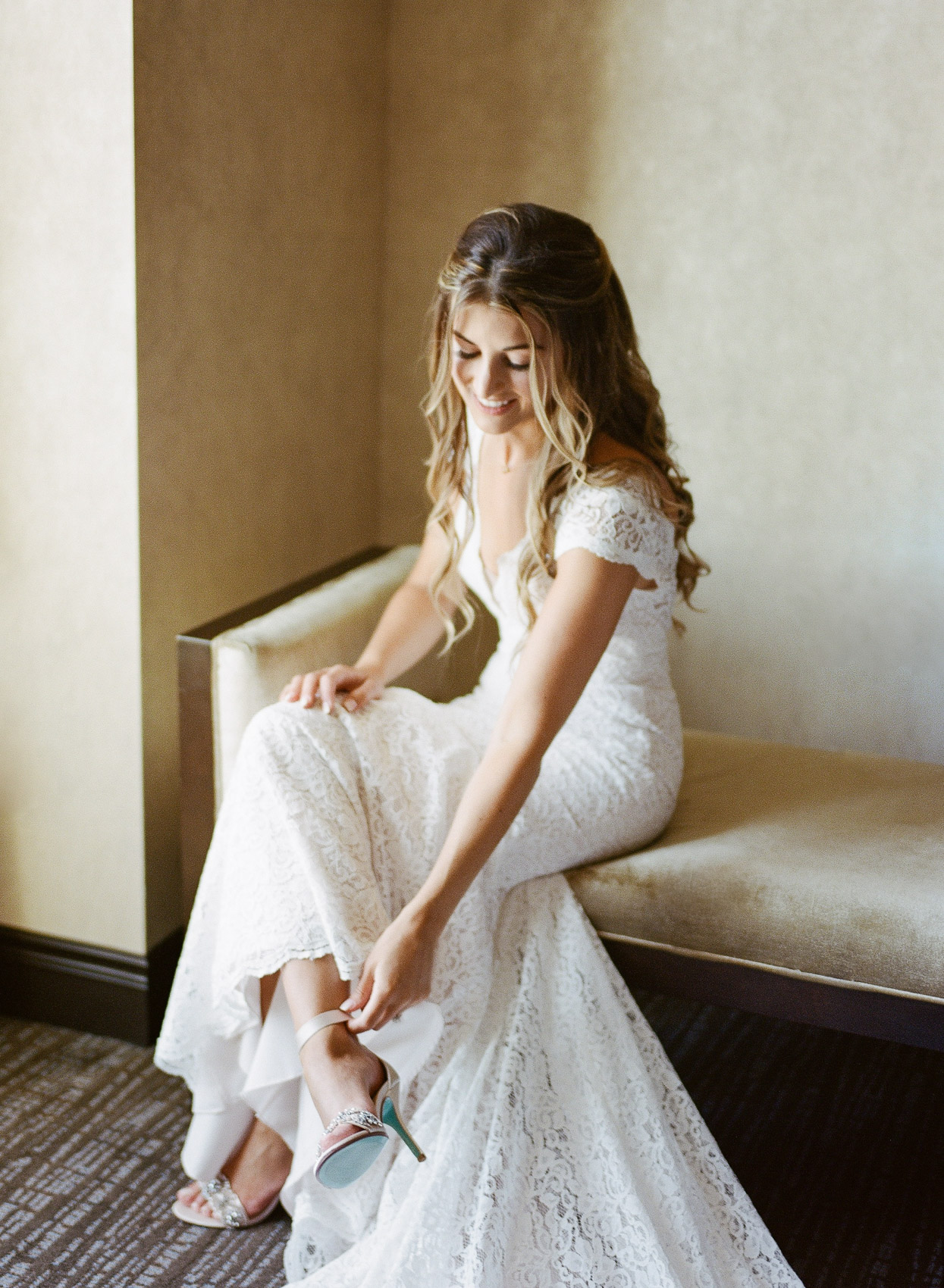 Bride putting on shoes in Saratoga Springs NY