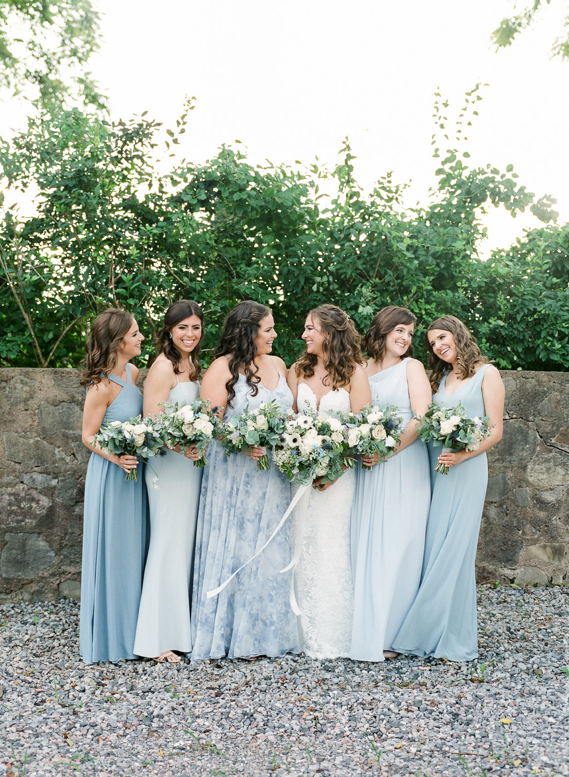 Blue bridesmaids in Jenny Yoo at Hotel du Village wedding in New Hope PA