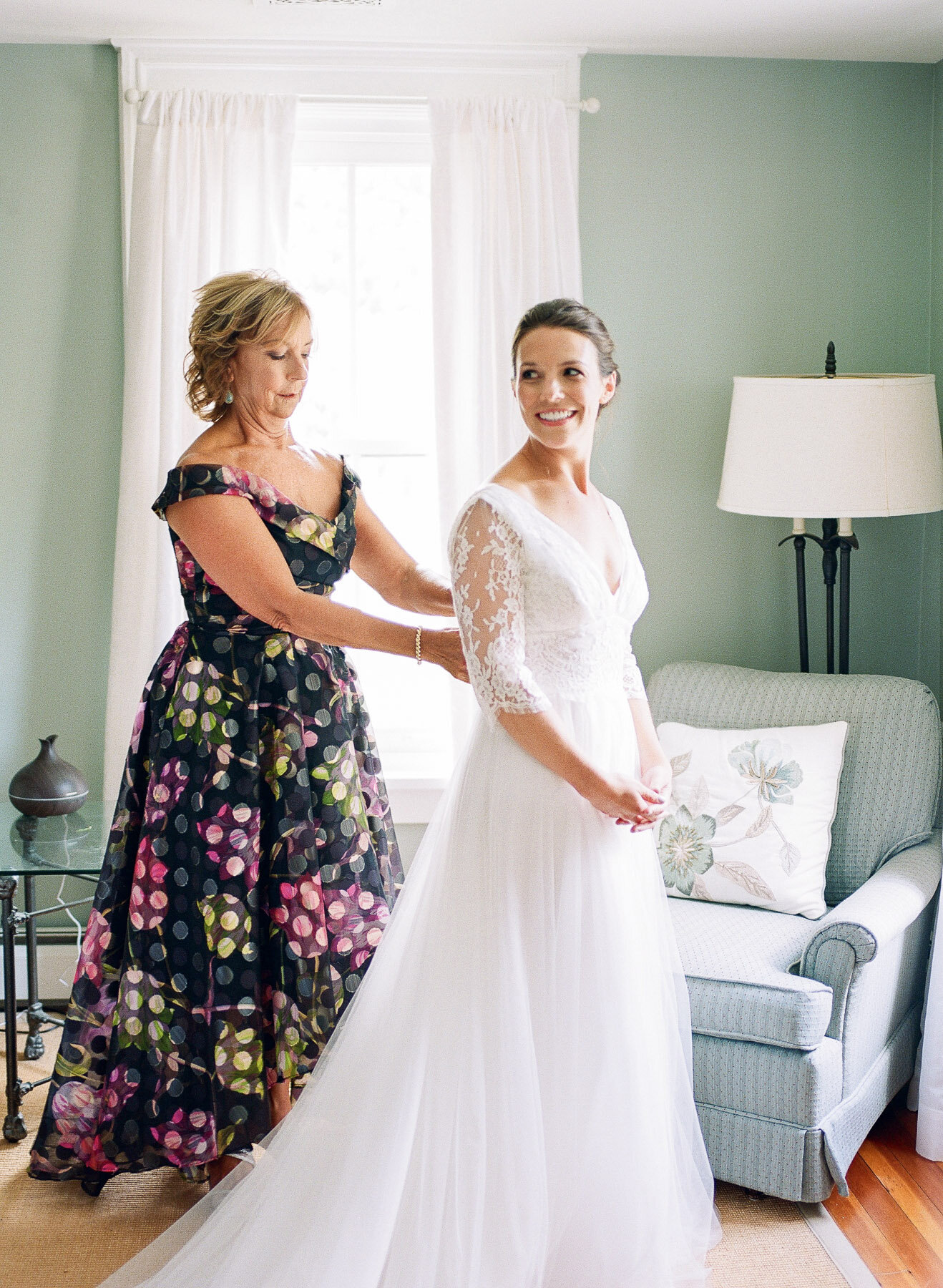 Mother of bride and bride getting dressed