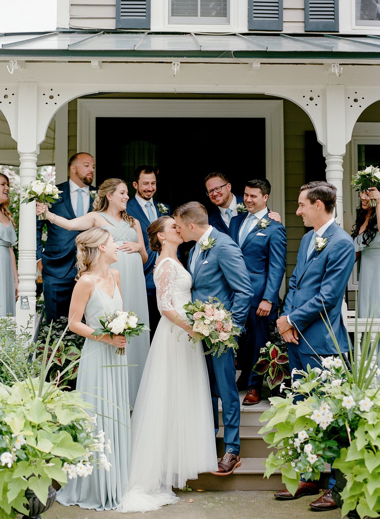 Photo of bridal party on porch