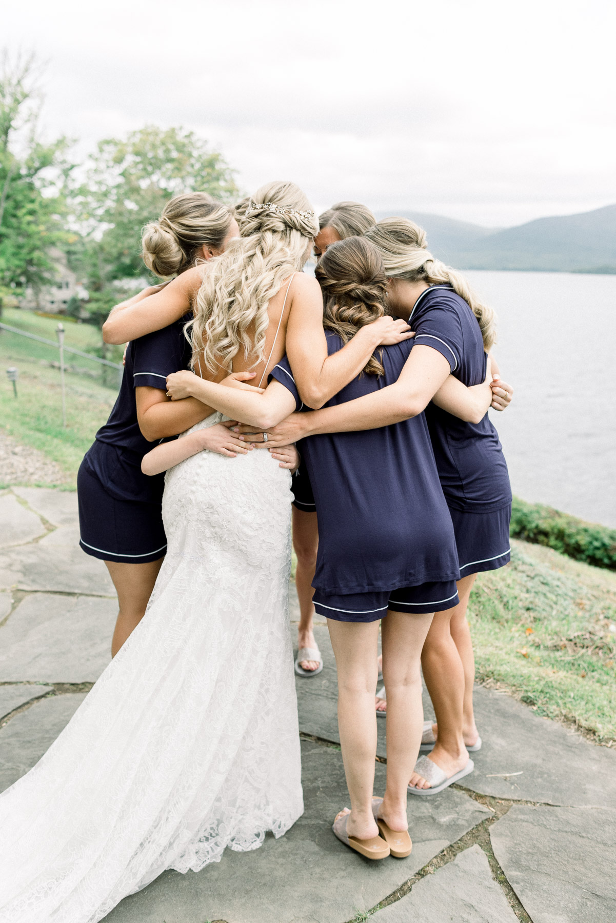 Bride hugs bridesmaids