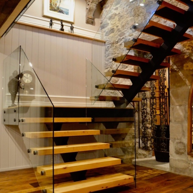stone+farmhouse+renovation+steel+stair+timber+tread+open+riser+glass+railng.jpg