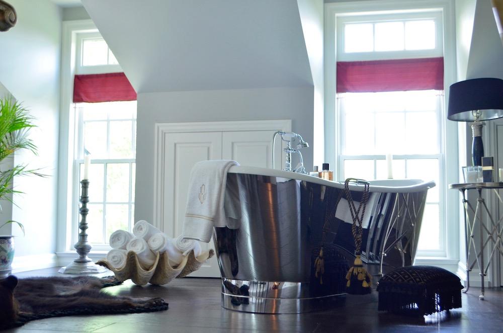 master suite bathtub stainless steel freestanding windows.jpeg