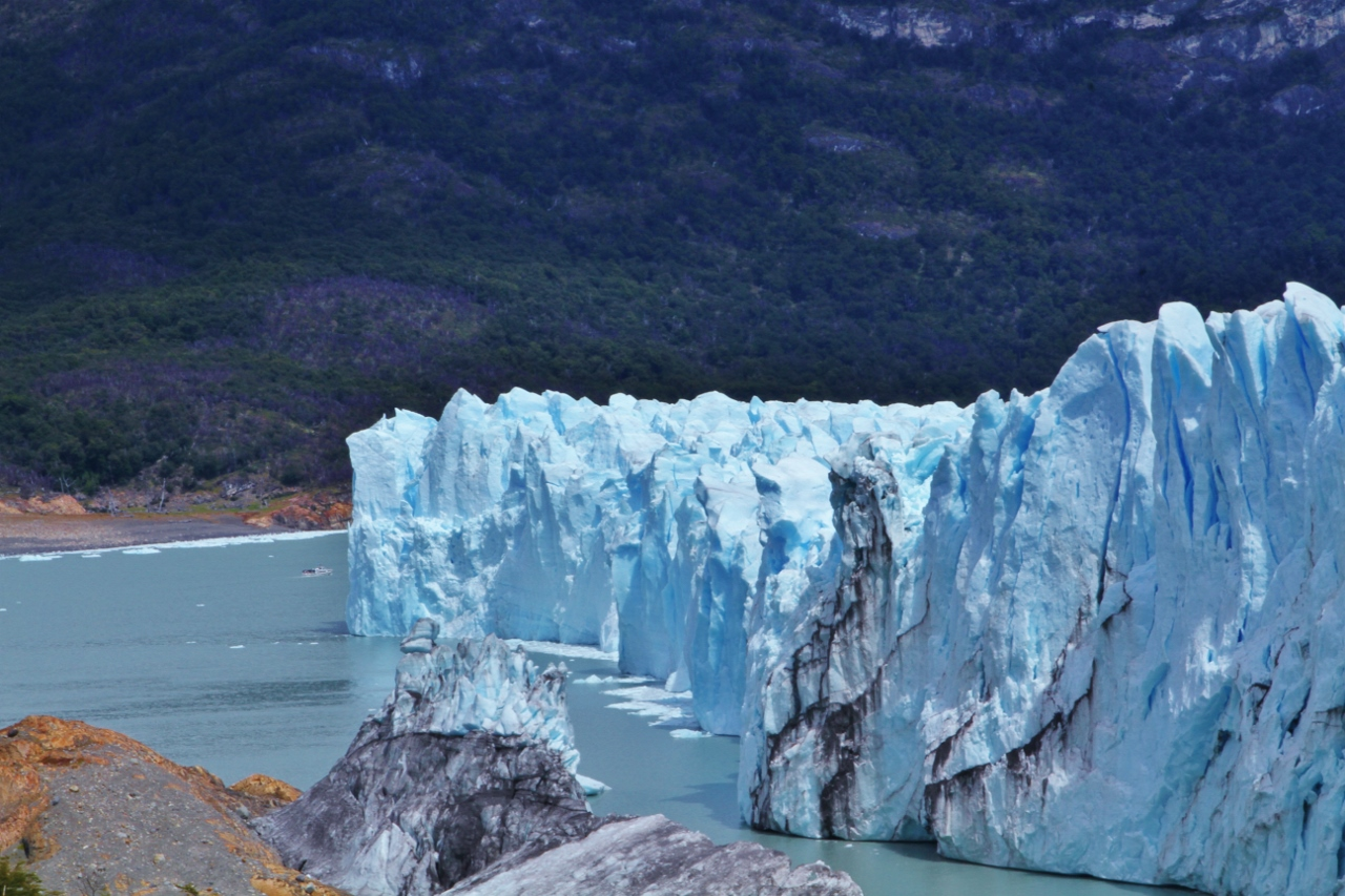 To get a sense of just how huge Perito Moreno is, here you can just barely see one of the tour boats (just to the left of the glacier face).   Those boats are double-decker catamarans (click here for a picture)