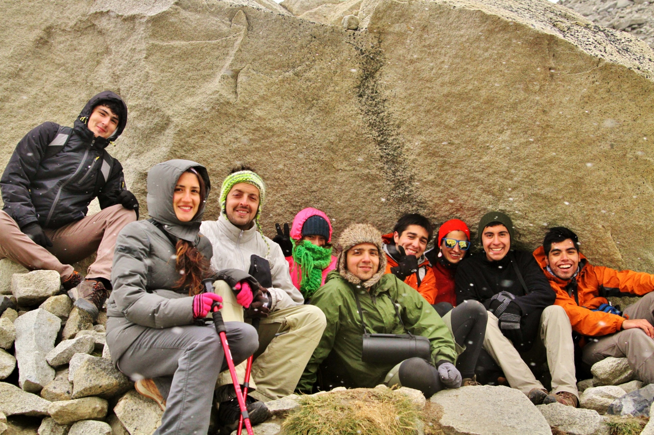 La Familia taking shelter from the snow and wind at the base of the Torres. From left to right: Oscar, Polette (a.k.a. Pollo), Christóbal, Tiziana, Ricardo, Sergio, Paula, Rodrigo, and Sergio