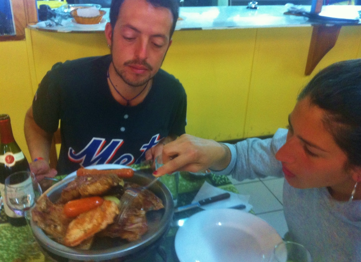 Christobal and Pollo dividing up our  parillada .  I got the cordero :)