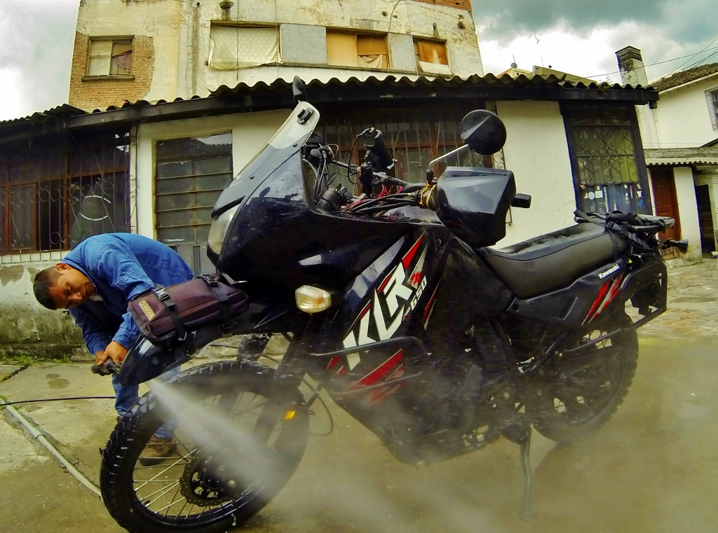 Baby's first bath since Punta Arenas, Chile, literally at the opposite end of the continent.  I'd almost forgotten the bike was black underneath all of that dust.