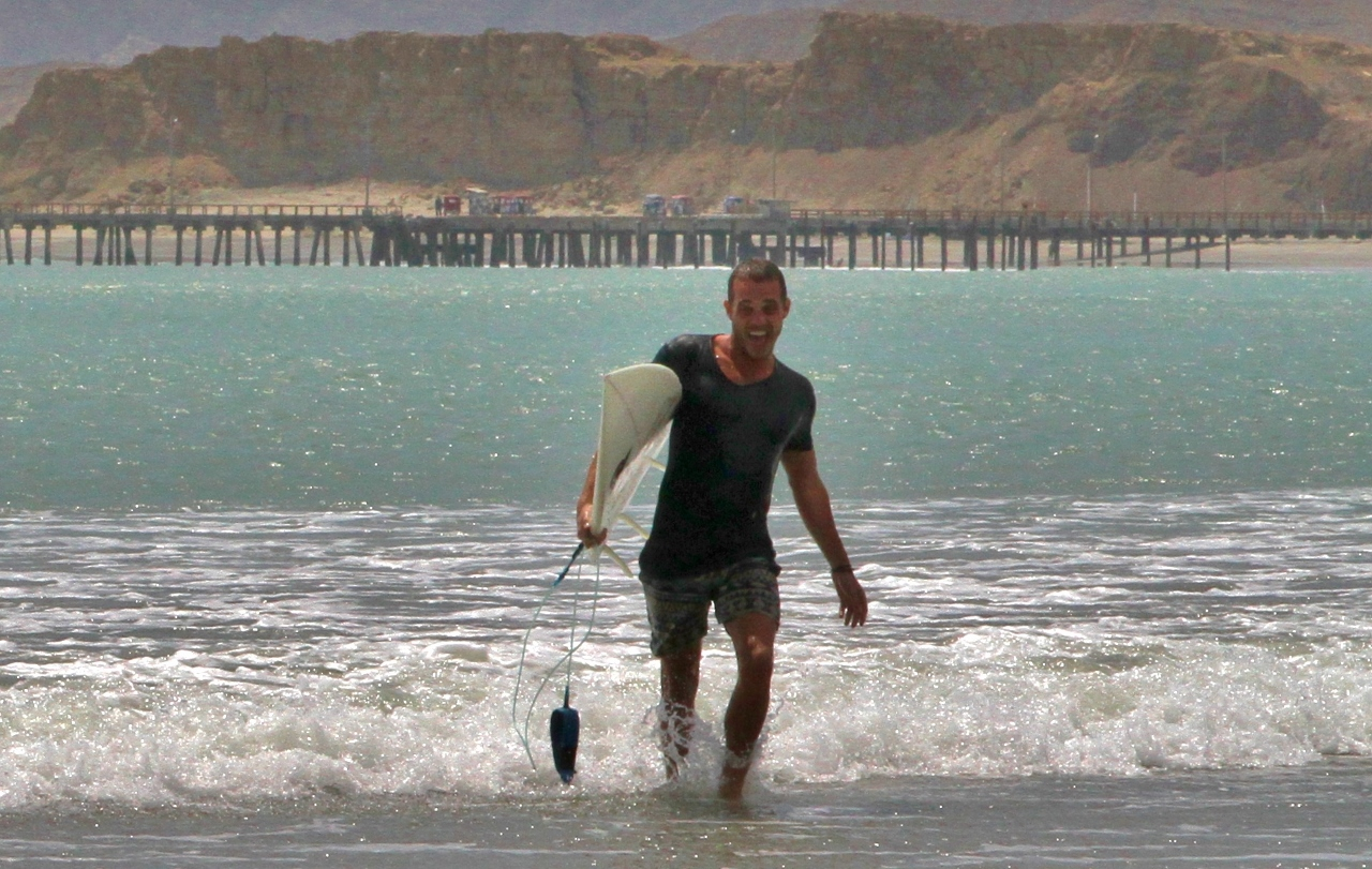 His surfboard brings all the boys to the yard