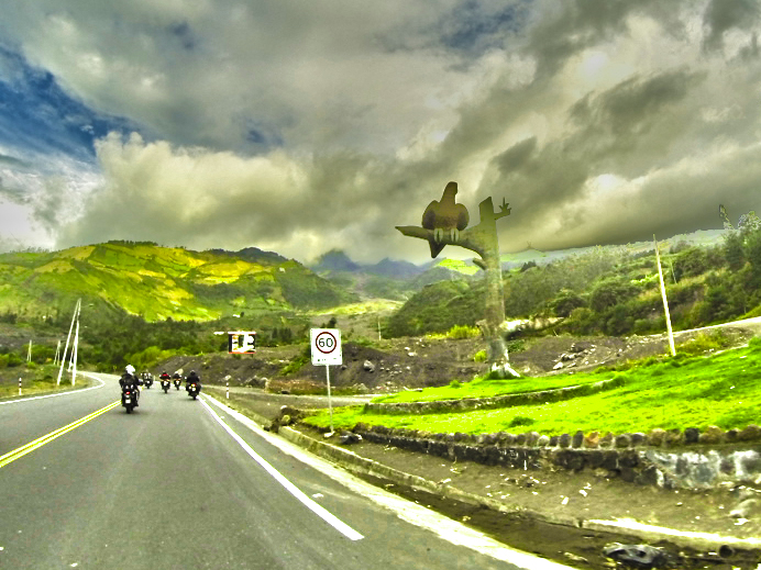 Riding to Baños with the Freedom Bike Rental tour group. The road was recently in an ash flow from Volcán Tunguragua, behind the clouds in the top left of the pic