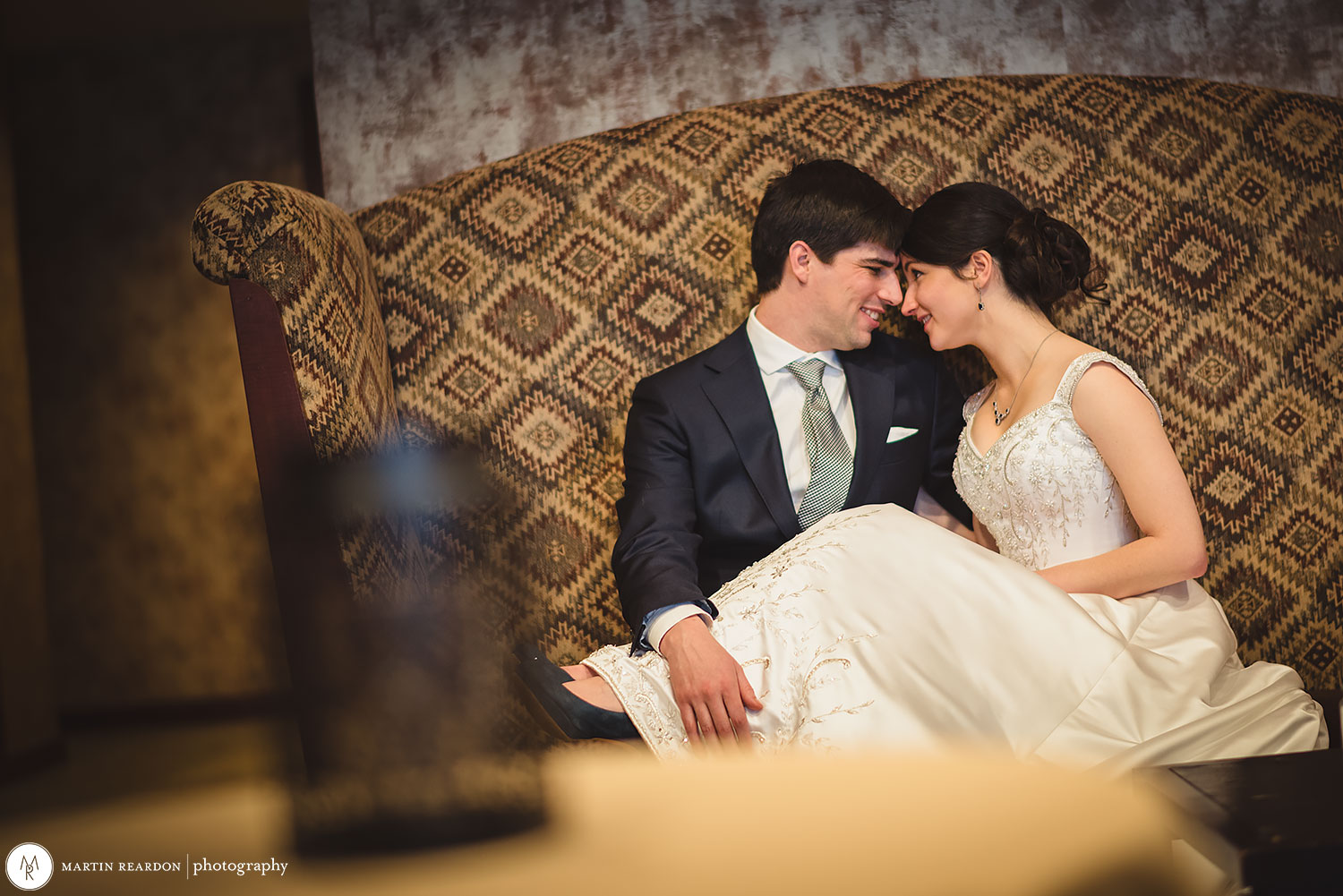 11-Bride-And-Groom-Sitting-On-Couch.jpg
