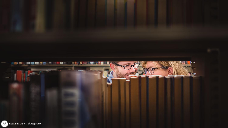 Engagement-shoot-couple-in-library-peek.jpg