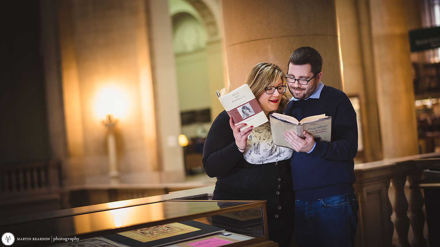 Engagement-shoot-couple-in-library-reading.jpg