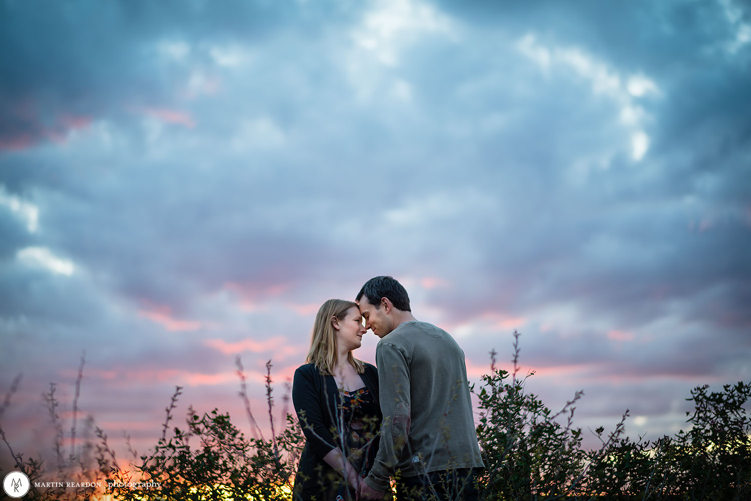 Engagement photo couple with dramatic sky