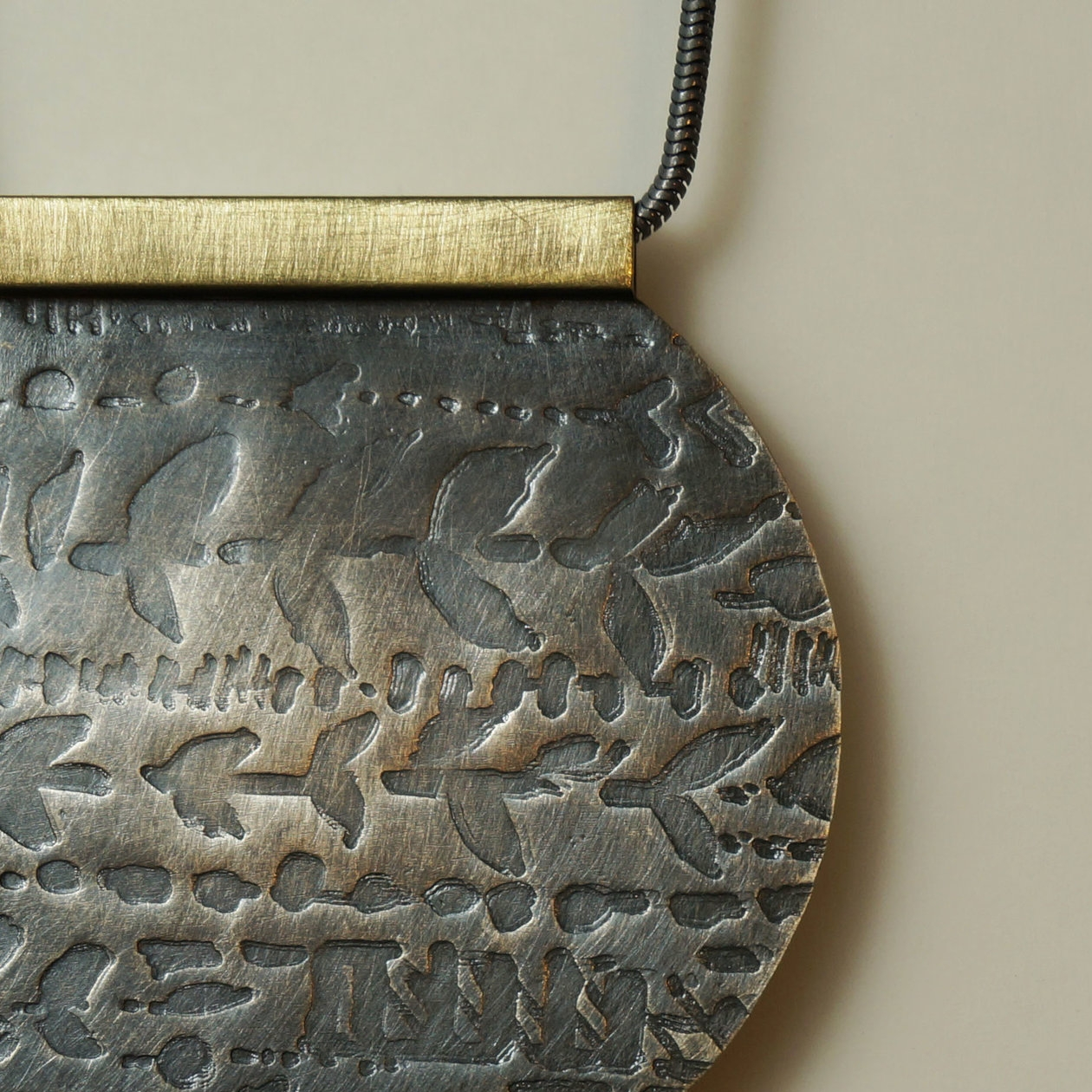 roll formed silver and brass necklace