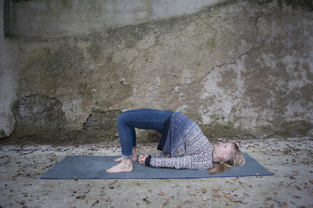The consistent practice of  Setu Bandhasana  (Bridge Pose) is said to reveal our inner power. This pose stretches the chest, neck, spine and legs and helps us to liberate our energy. In the practice of the pose we also assist  the digestion, calm the brain and   stimulate the thyroid and parathyroid glands.   Variation:   B y using a block under the sacrum for support we can create a restorative pose.