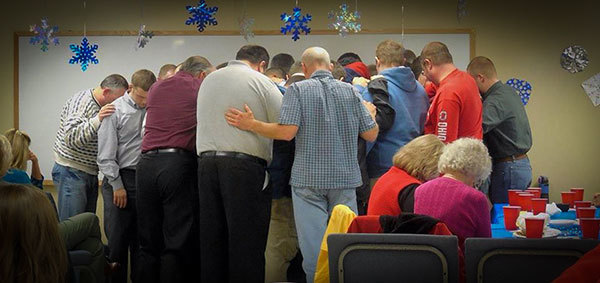 """The Bear Valley students and staff """"sending out"""" our two newest graduates in prayer."""