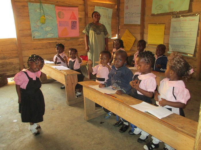 brightland nursery kids saying their memory verses from the Bible with demostrations.JPG
