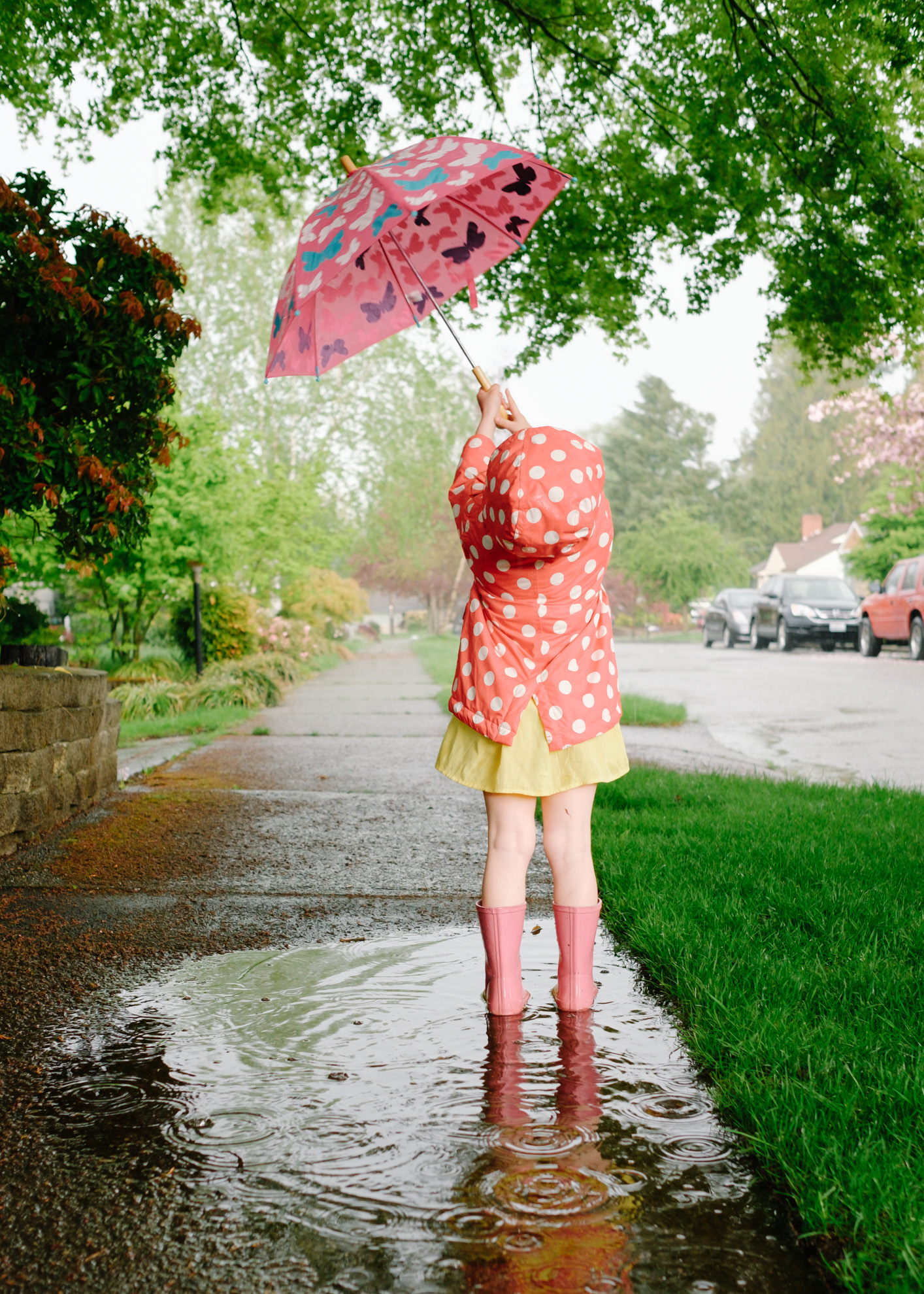 PHOTO I TOOK - The girl and I on a spring afternoon in search of puddles to jump in. I aspire to make great photographs but really, I just take pictures and a few turn out okay. I really like this one. It just captures the girl perfectly.