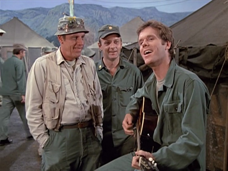 Loudon Wainwright III on the set of M*A*S*H