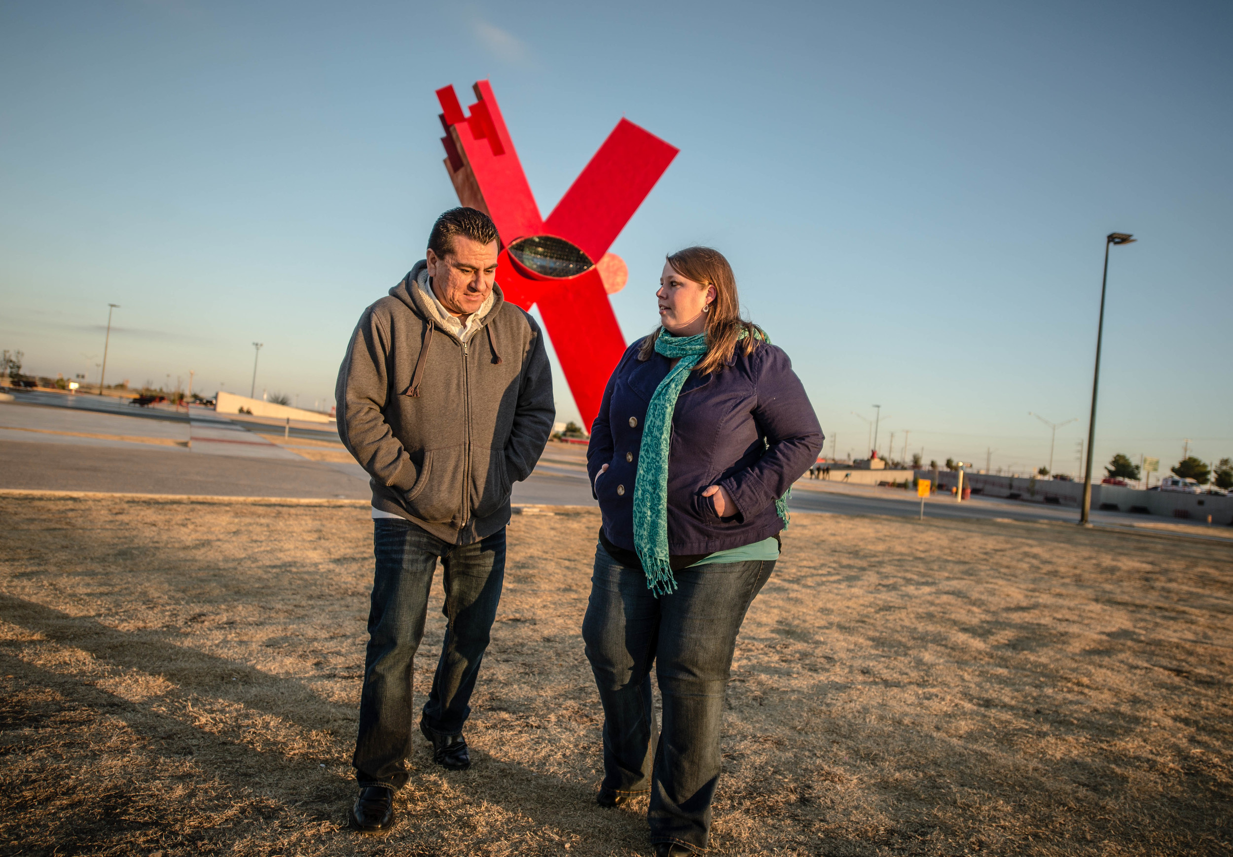 "Raymundo and Emily Cruz walk on the esplanade under the X sculpture by the Mexican artist known as Sebastian, which Emily in her blog has called a symbol of Ciudad Juárez's renewal, ""the promise of a new beginning."" (Roberto E. Rosales/Albuquerque Journal)"