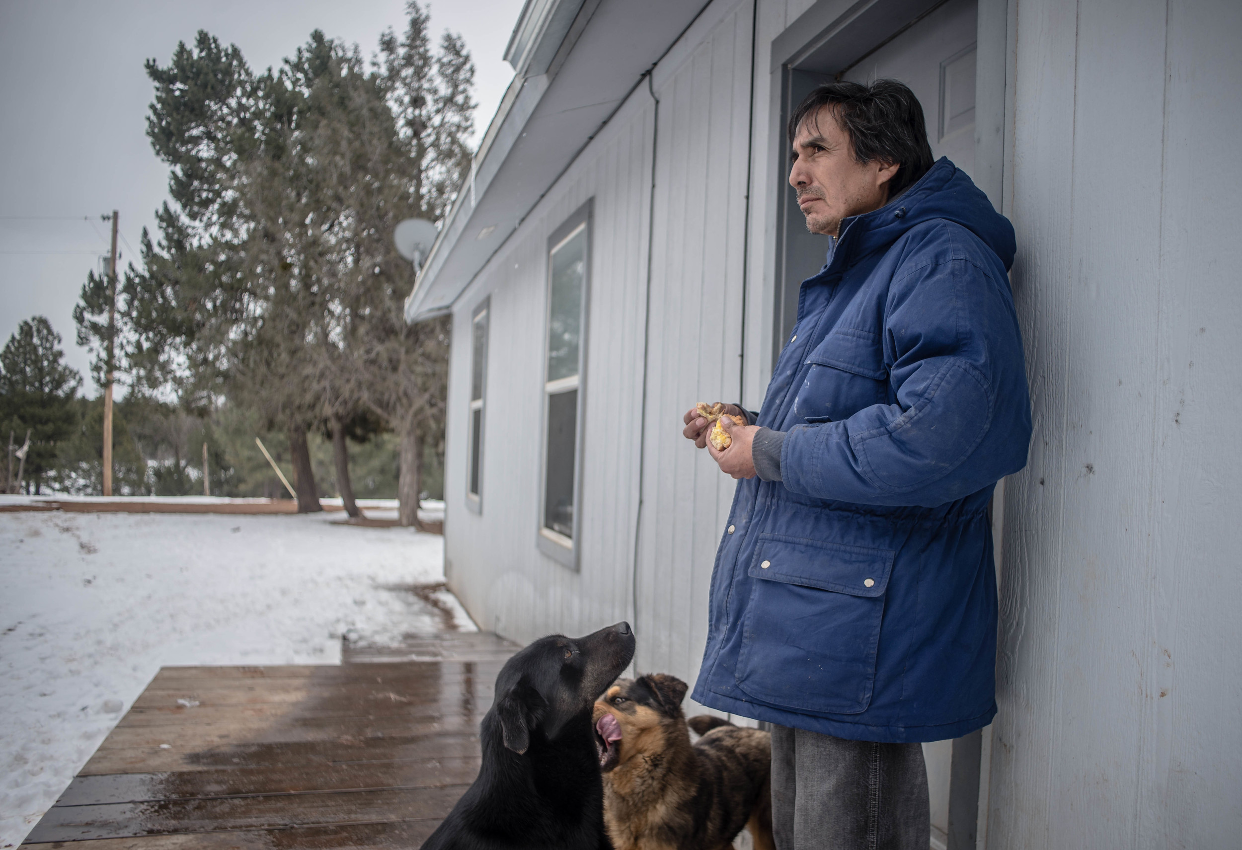 Jasper Peshlakai stands In front of his home atop a hill near Crystal on Thursday, recounting the story his niece told him about the niece's kicking a mother and her 13-month-old child out of her truck. The child was found dead the next morning in a culvert. (Roberto E. Rosales/Albuquerque Journal)
