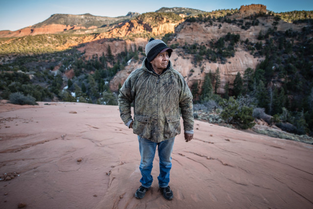 James Smith, 70, surveys five former Kerr-McGee uranium mine sites near his home in Cove, Ariz., where Smith, his three brothers, and hundreds of other Navajos tunneled into the rugged Lukachukai Mountains. Radioactive material hauled from the mines remains piled in populated areas of Cove while officials decide how to dispose of abandoned mine waste. (Roberto E. Rosales/Albuquerque Journal)