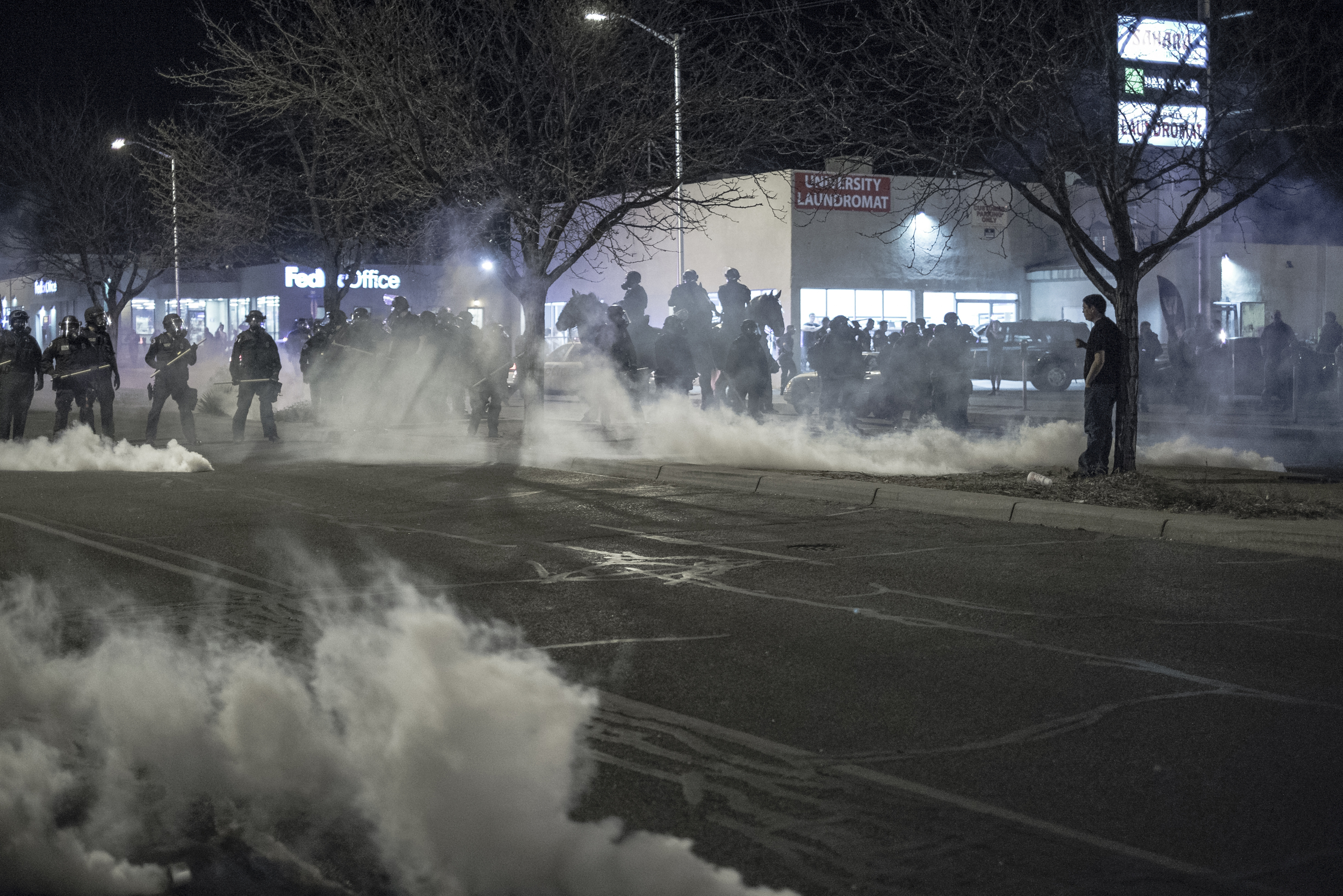 Albuquerque Police begin to throw tear gas at protesters on Central Avenue near the University of New Mexico.