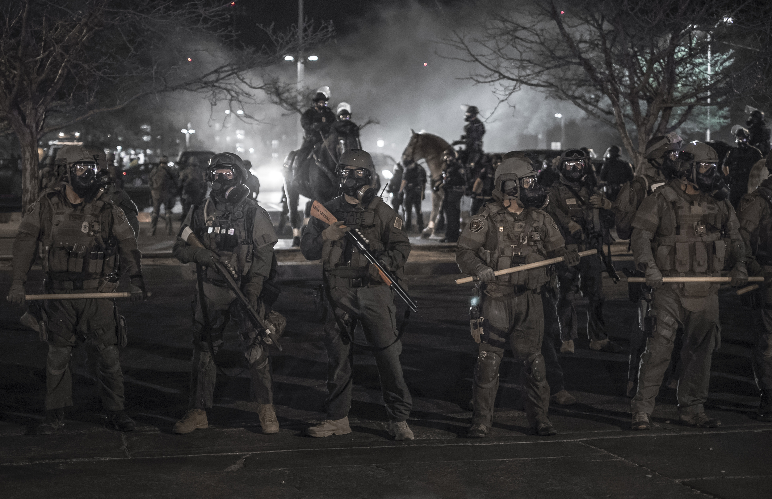 Albuquerque riot police force protesters off the streets on Central Avenue.