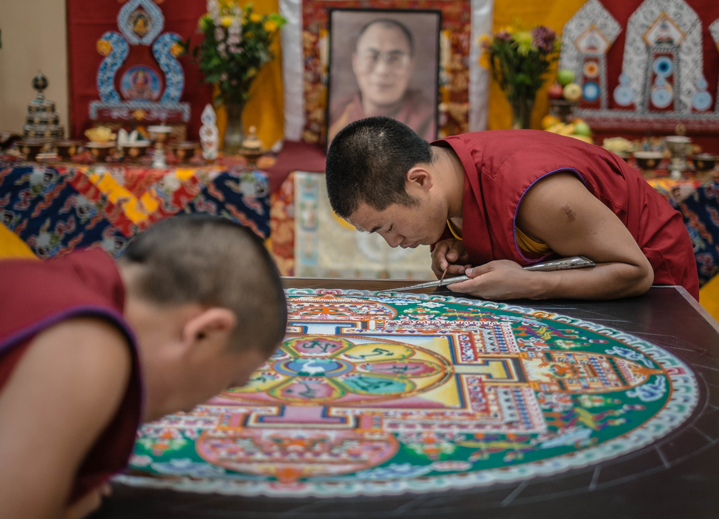 Tibetan monks continue work on a Mandela before performing at the University of New Meixco