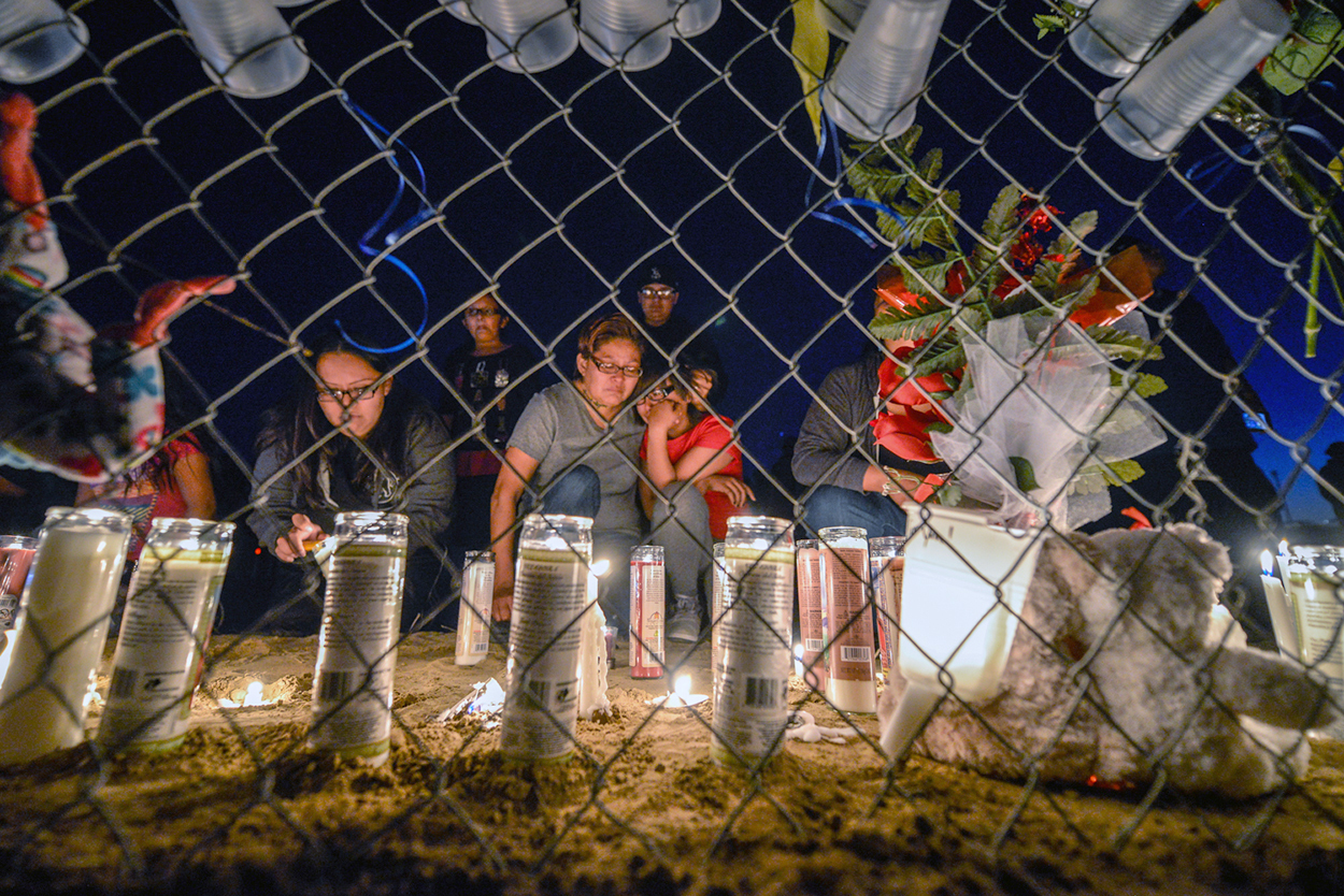 Mourners gather at a memorial for 11 year old Ashlynn Mike who was kidnapped and killed near Shiprock, New Mexico.