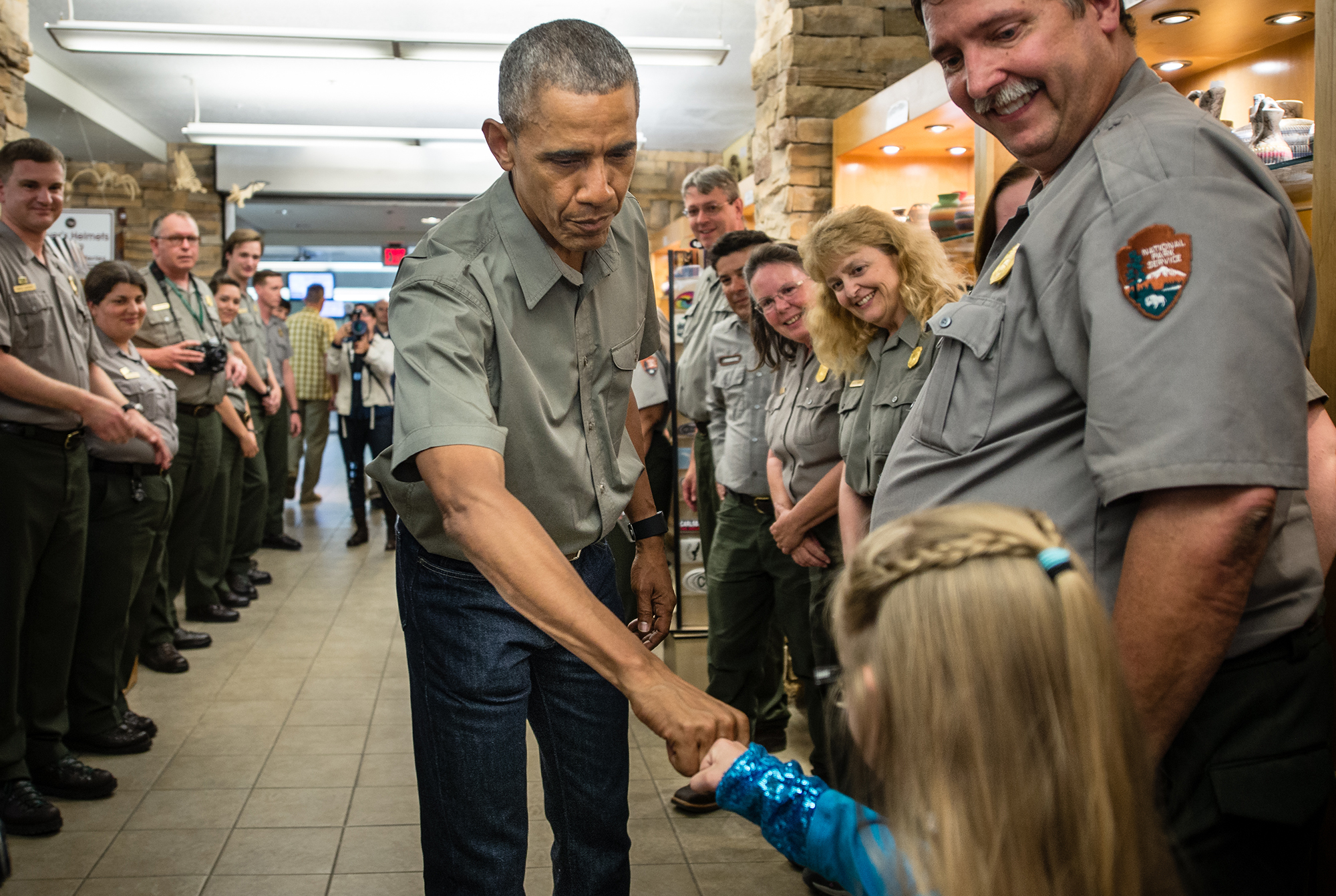 President Barack Obama high fives a young girl during his visit to Carlsbad Caverns in New Mexico on June 2016.